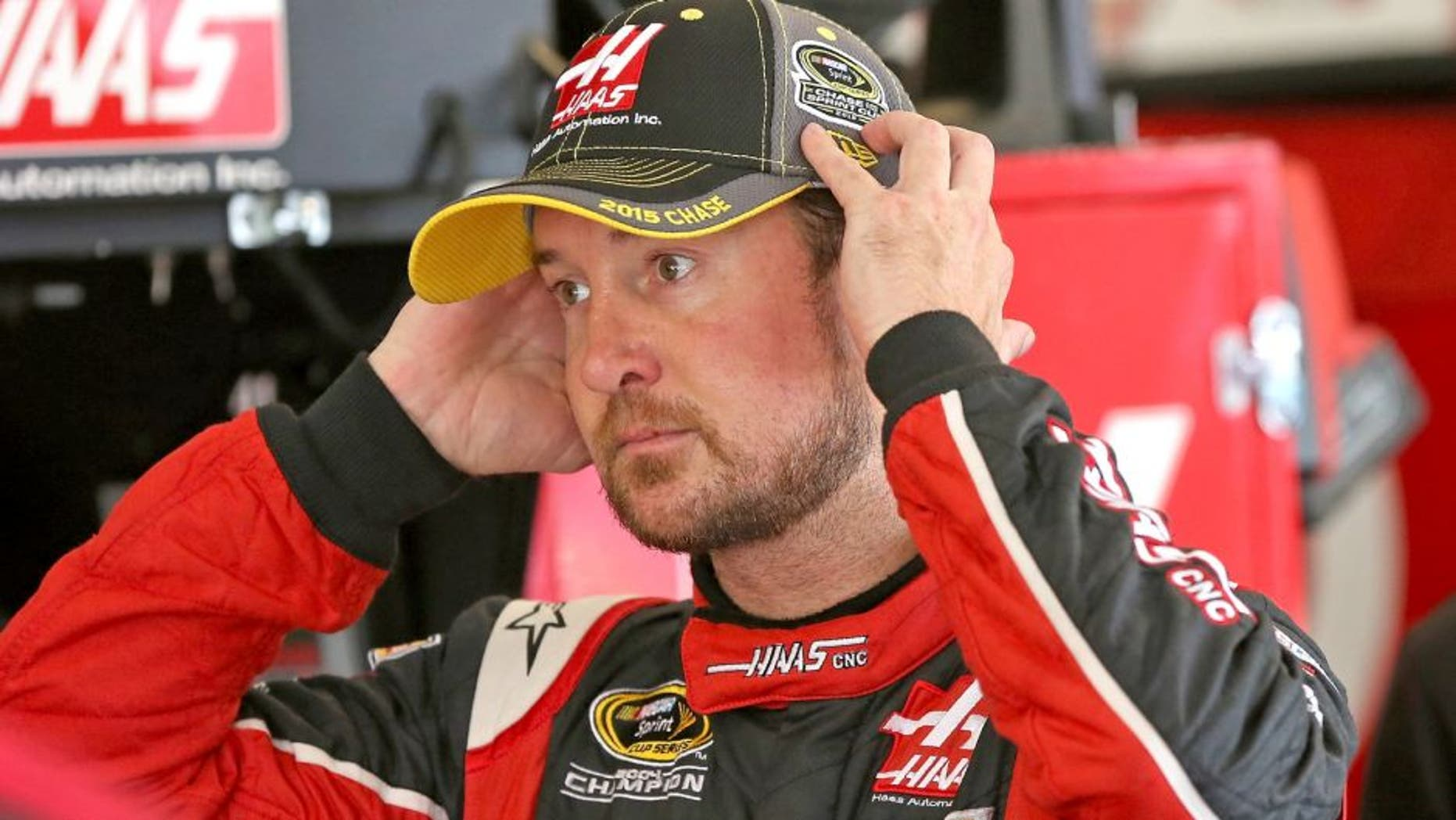 JOLIET, IL - SEPTEMBER 19: Kurt Busch, driver of the #41 Haas Automation Chevrolet, stands in the garage area during practice for the NASCAR Sprint Cup Series MyAFibRisk.com 400 at Chicagoland Speedway on September 19, 2015 in Joliet, Illinois. (Photo by Jonathan Daniel/Getty Images)