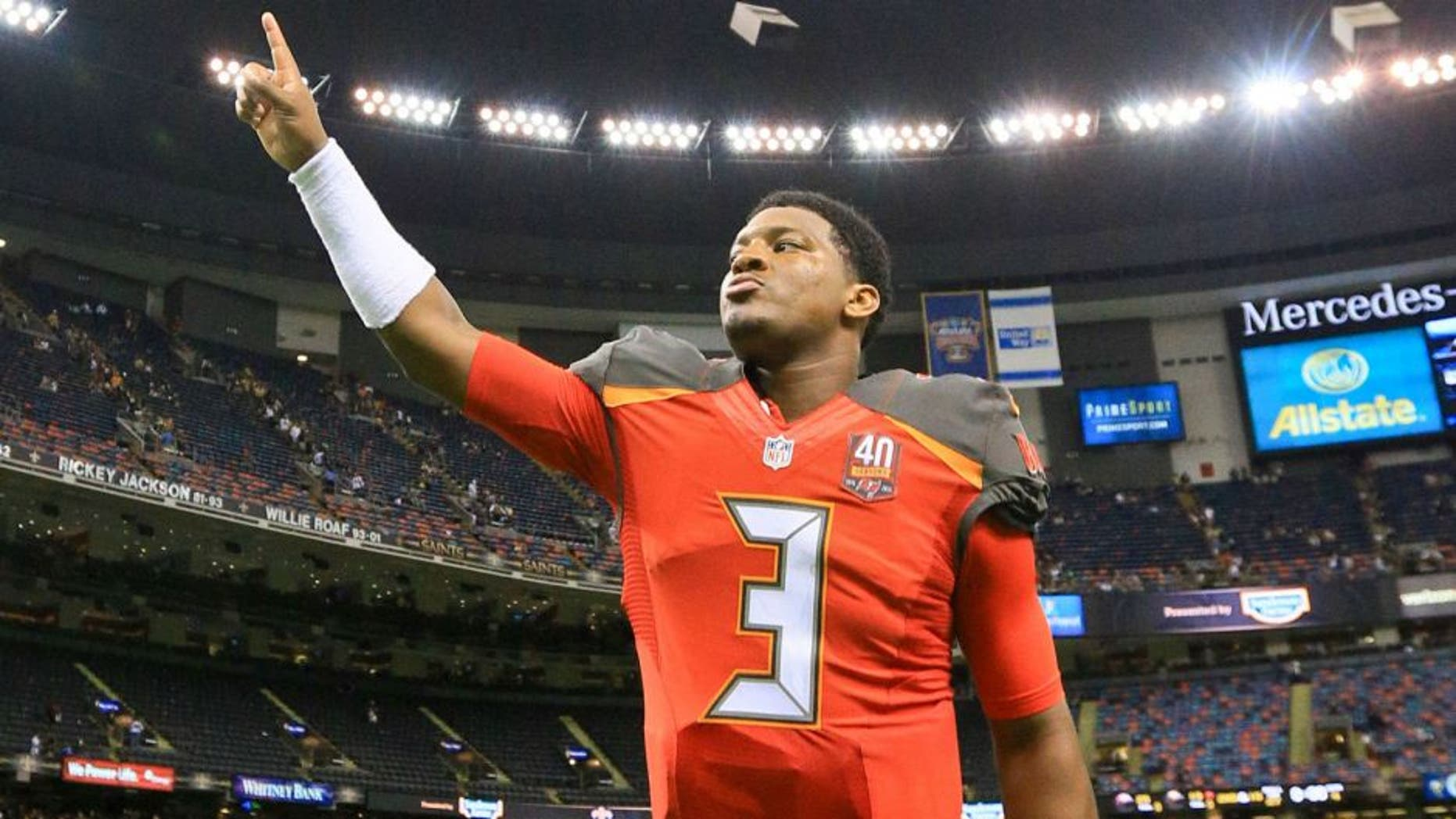 Sep 20, 2015; New Orleans, LA, USA; Tampa Bay Buccaneers quarterback Jameis Winston (3) celebrates as he leaves the field following his first career win in the NFL coming against the New Orleans Saints in a game at the Mercedes-Benz Superdome. The Buccaneers defeated the Saints 26-19. Mandatory Credit: Derick E. Hingle-USA TODAY Sports