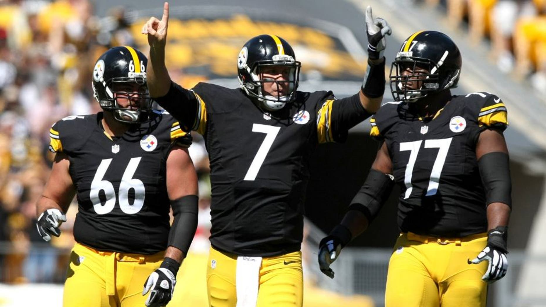 Sep 20, 2015; Pittsburgh, PA, USA; Pittsburgh Steelers quarterback Ben Roethlisberger (7) celebrates a touchdown pass with guard David DeCastro (66) and offensive tackle Marcus Gilbert (77) against the San Francisco 49ers during the first half at Heinz Field. Mandatory Credit: Jason Bridge-USA TODAY Sports
