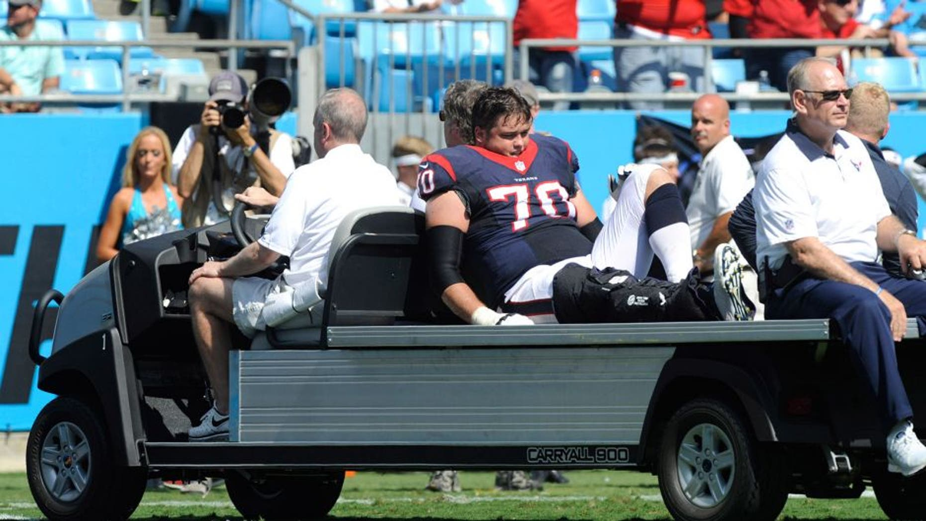 Sep 20, 2015; Charlotte, NC, USA; Houston Texans tackle Jeff Adams (70) is carted off the field after hurting his leg during the first half of the game against the Carolina Panthers at Bank of America Stadium. Mandatory Credit: Sam Sharpe-USA TODAY Sports