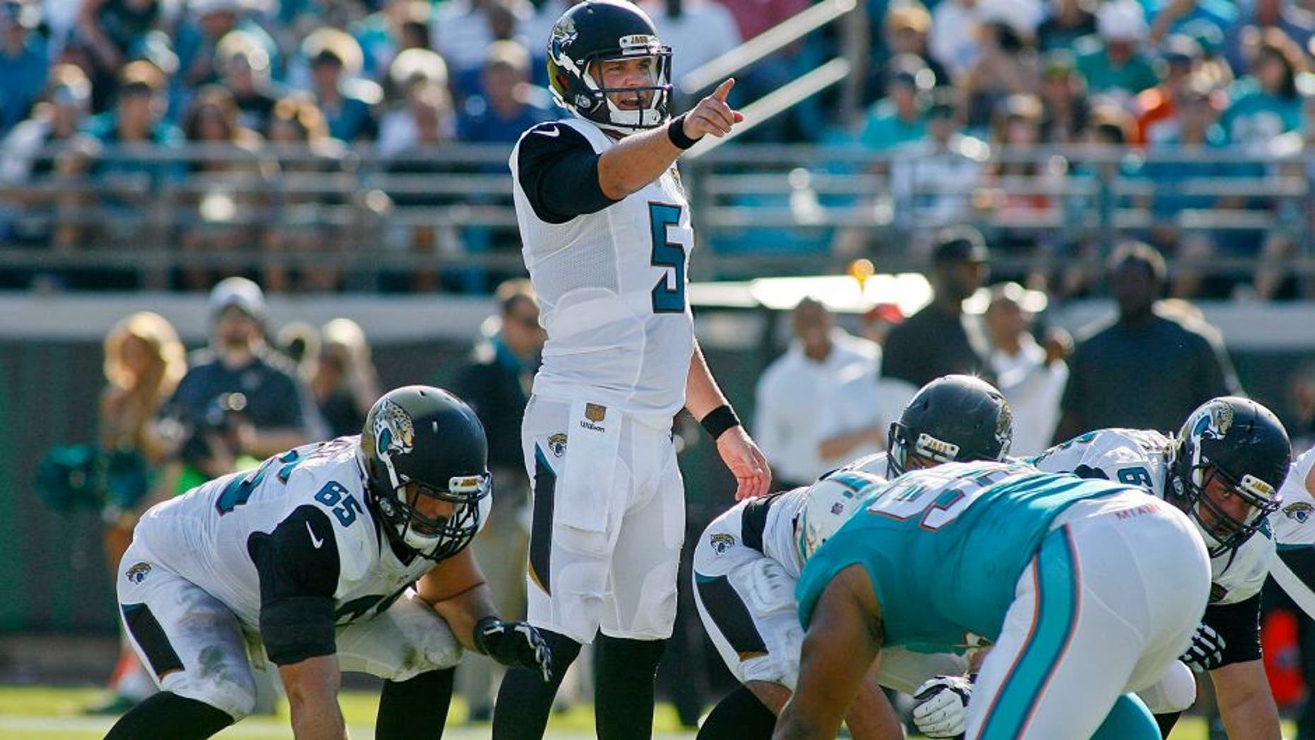 Sep 20, 2015; Jacksonville, FL, USA; Jacksonville Jaguars quarterback Blake Bortles (5) points at the line of scrimmage in the second quarter against the Miami Dolphins at EverBank Field. Mandatory Credit: Phil Sears-USA TODAY Sports