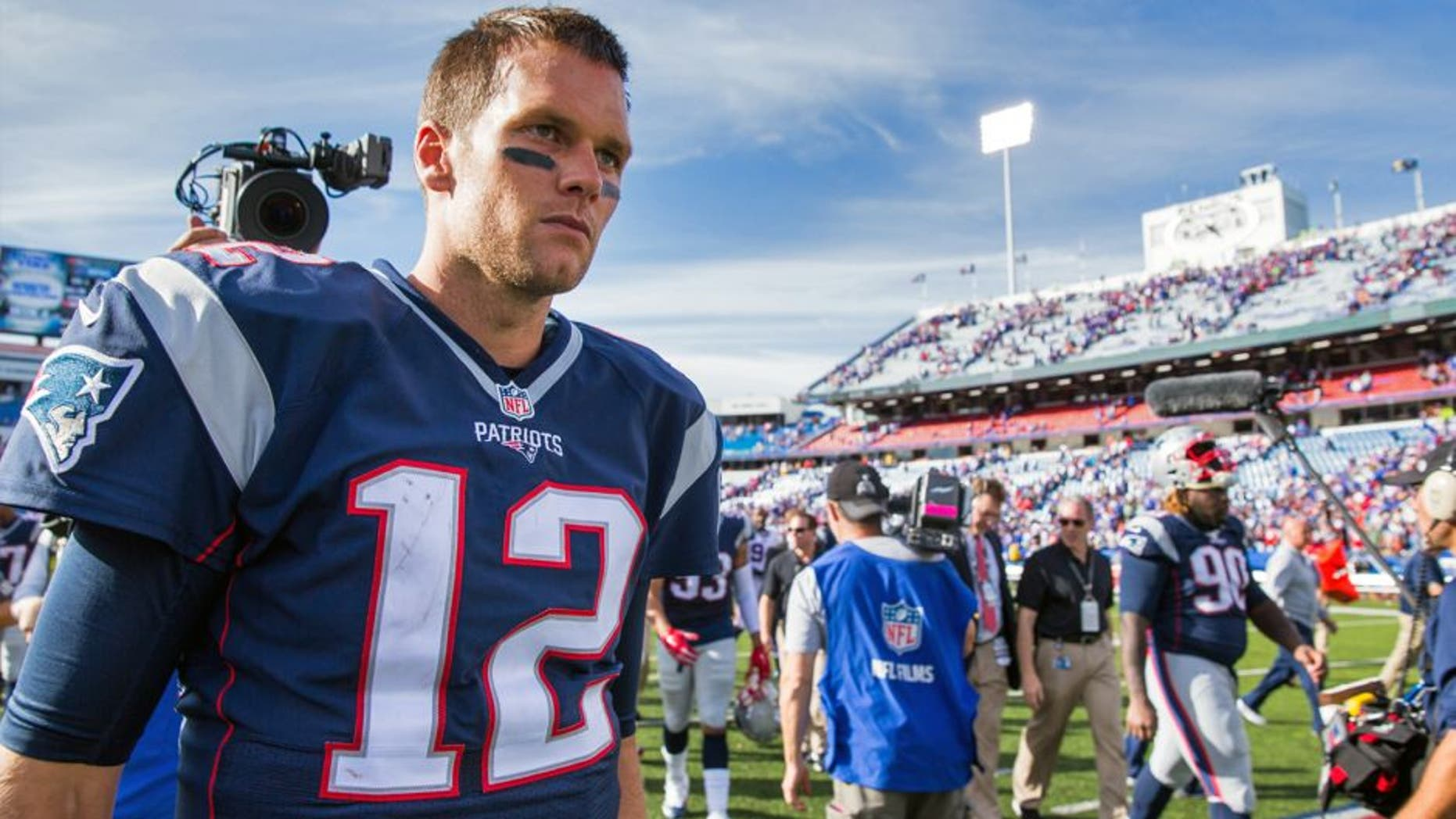 ORCHARD PARK, NY - SEPTEMBER 20: Tom Brady #12 of the New England Patriots walks off the field after the win against the Buffalo Bills on September 20, 2015 at Ralph Wilson Stadium in Orchard Park, New York. New England defeats Buffalo 40-32. (Photo by Brett Carlsen/Getty Images)