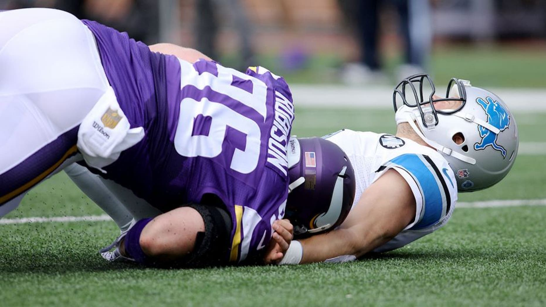 MINNEAPOLIS, MN - SEPTEMBER 20: Brian Robison #96 of the Minnesota Vikings tackles Matthew Stafford #9 of the Detroit Lions in the first quarter at TCF Bank Stadium on September 20, 2015 in Minneapolis, Minnesota. (Photo by Adam Bettcher/Getty Images)