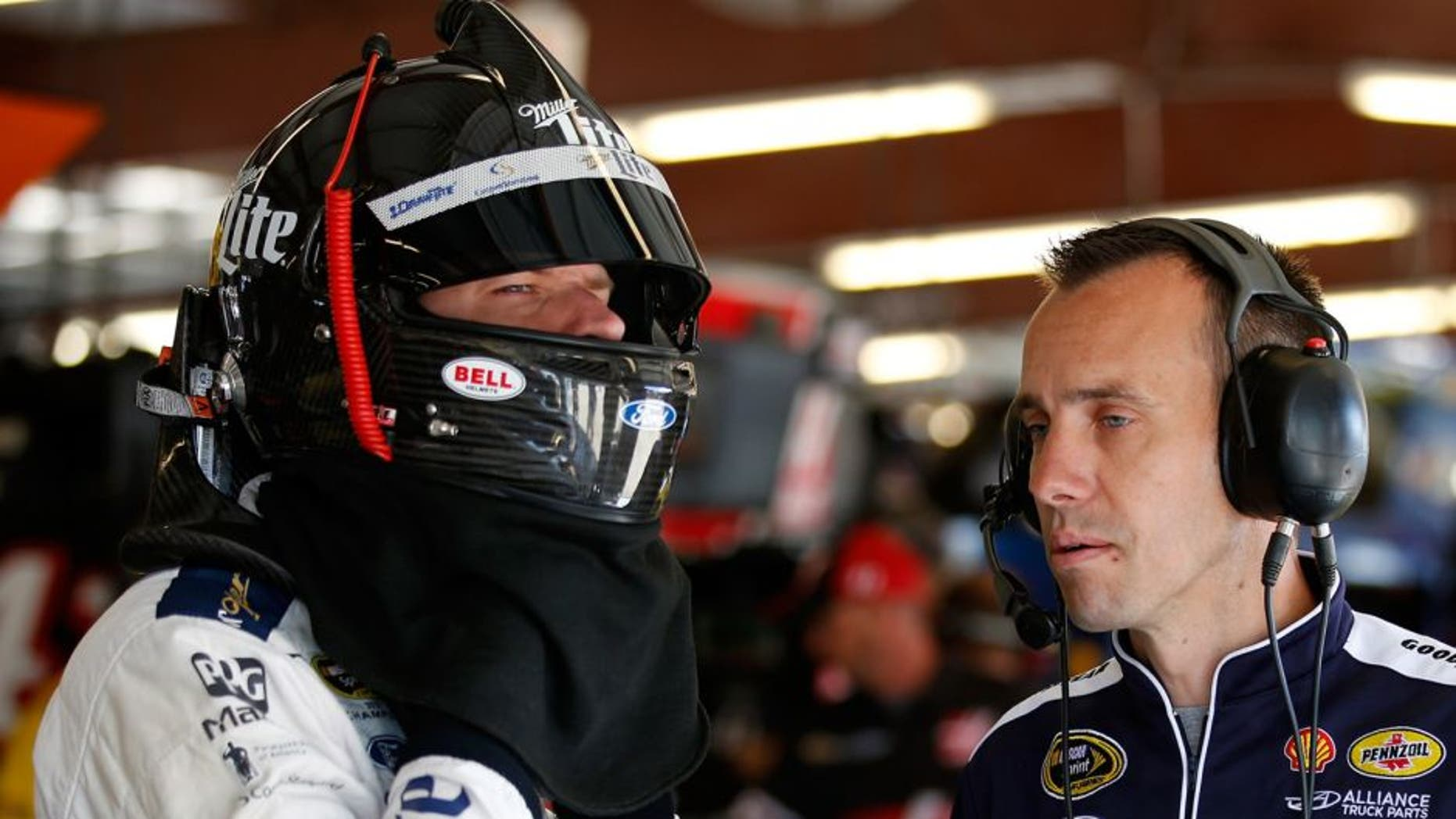 JOLIET, IL - SEPTEMBER 19: Brad Keselowski, driver of the #2 Miller Lite Ford, talks with his crew chief Paul Wolfe during practice for the NASCAR Sprint Cup Series MyAFibRisk.com 400 at Chicagoland Speedway on September 19, 2015 in Joliet, Illinois. (Photo by Todd Warshaw/NASCAR via Getty Images)