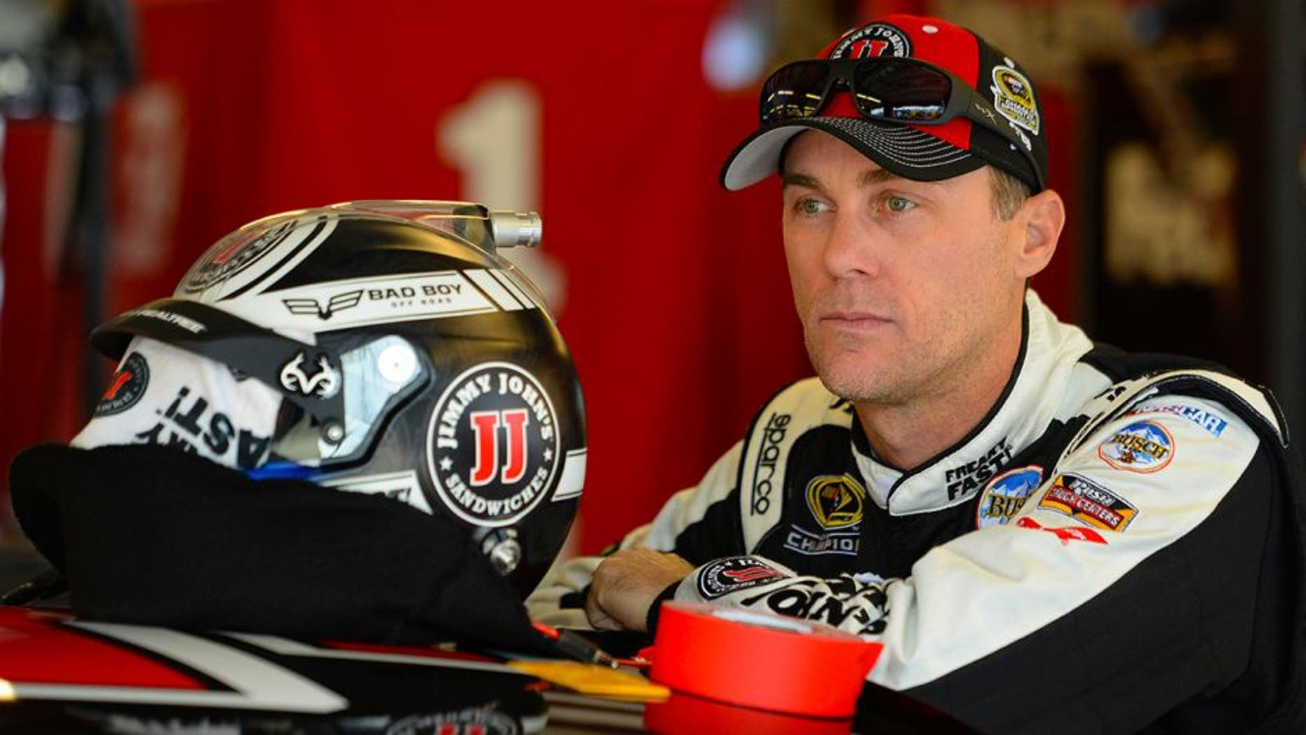 JOLIET, IL - SEPTEMBER 17: Kevin Harvick, driver of the #4 Jimmy John's Chevrolet, stands in the garage area during practice for the NASCAR Sprint Cup Series Teenage Mutant Ninja Turtles 400 at Chicagoland Speedway on September 17, 2016 in Joliet, Illinois. (Photo by Robert Laberge/Getty Images)