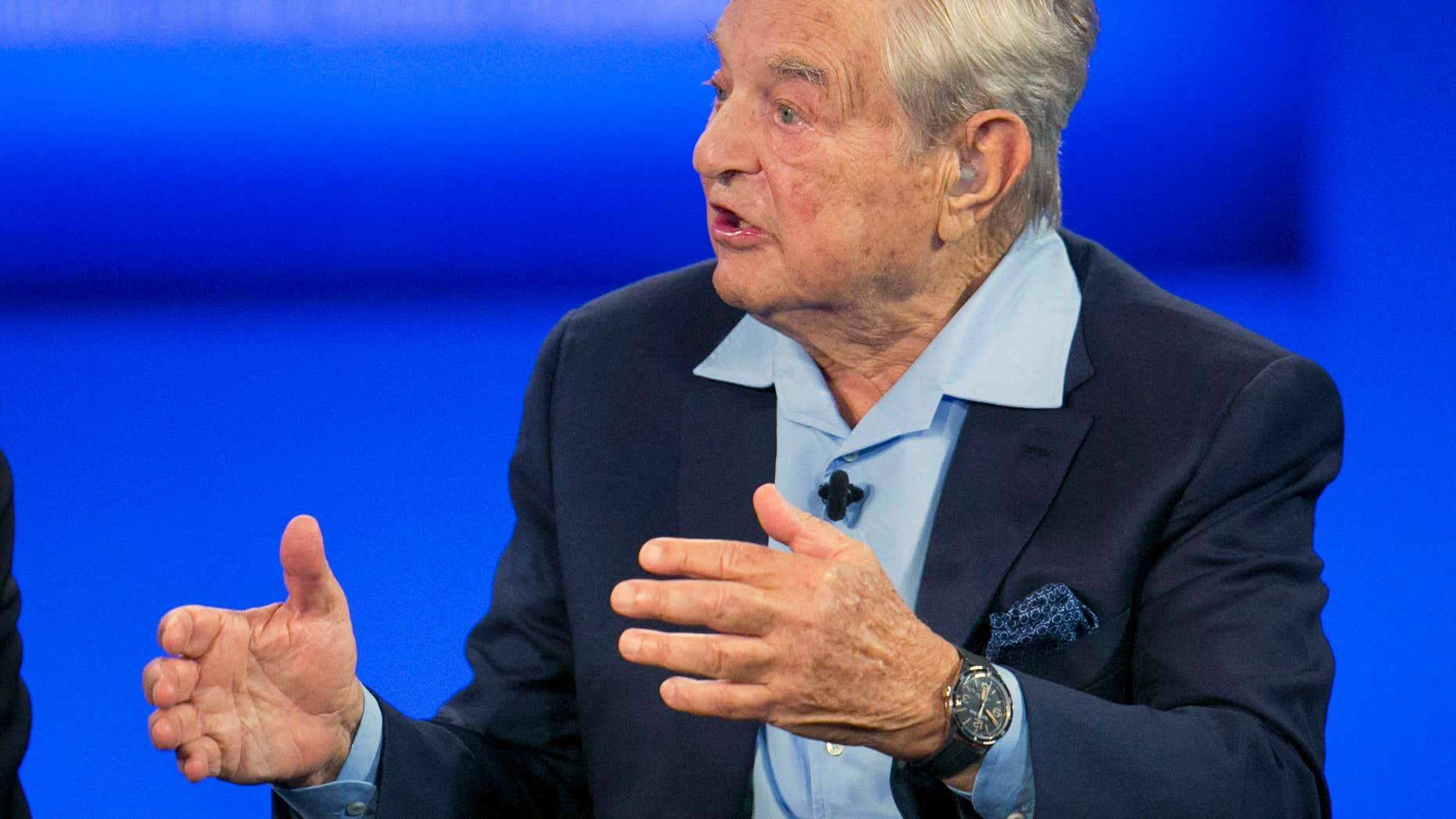 FILE - In this Sept. 27, 2015, file photo, George Soros, chairman of Soros Fund Management, talks during a television interview for CNN at the Clinton Global Initiative in New York.