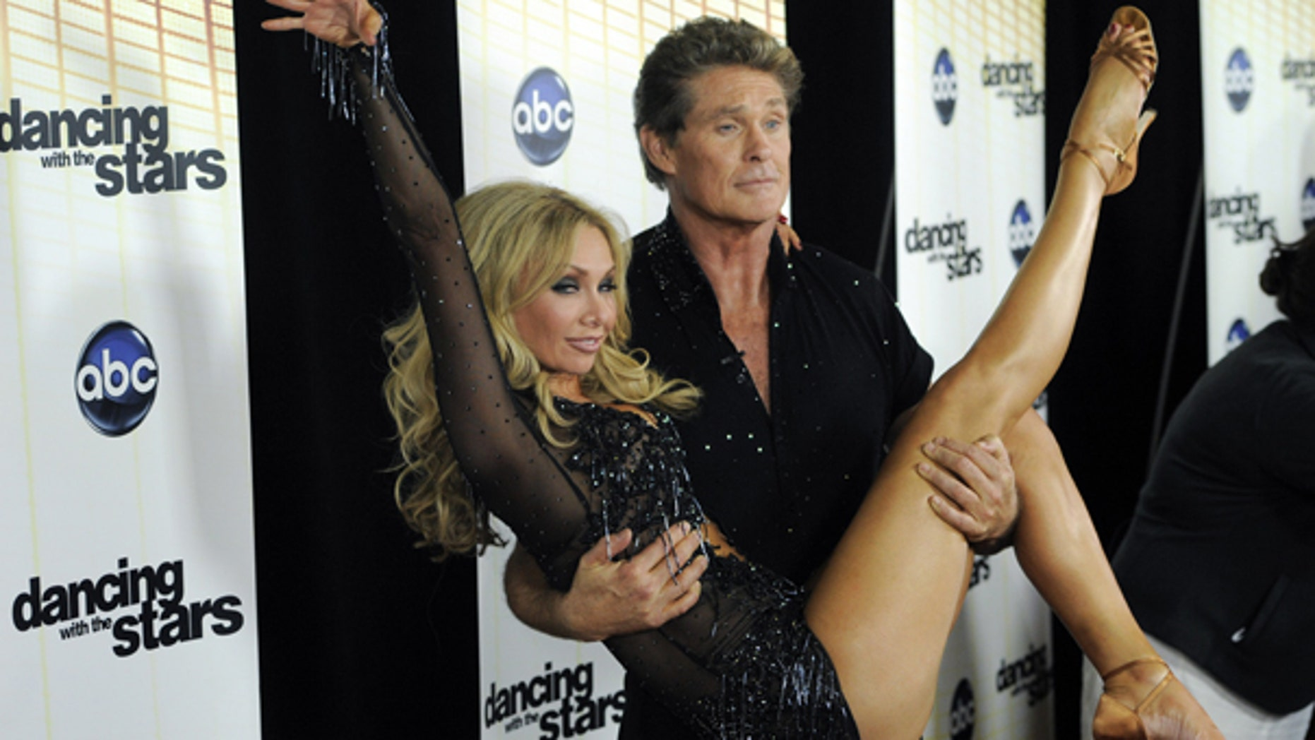 Sept. 20: Contestant David Hasselhoff and his dance partner Kym Johnson pose together following the 11th season premiere of 'Dancing with the Stars.' Hasselhoff was the first to get voted off the show.