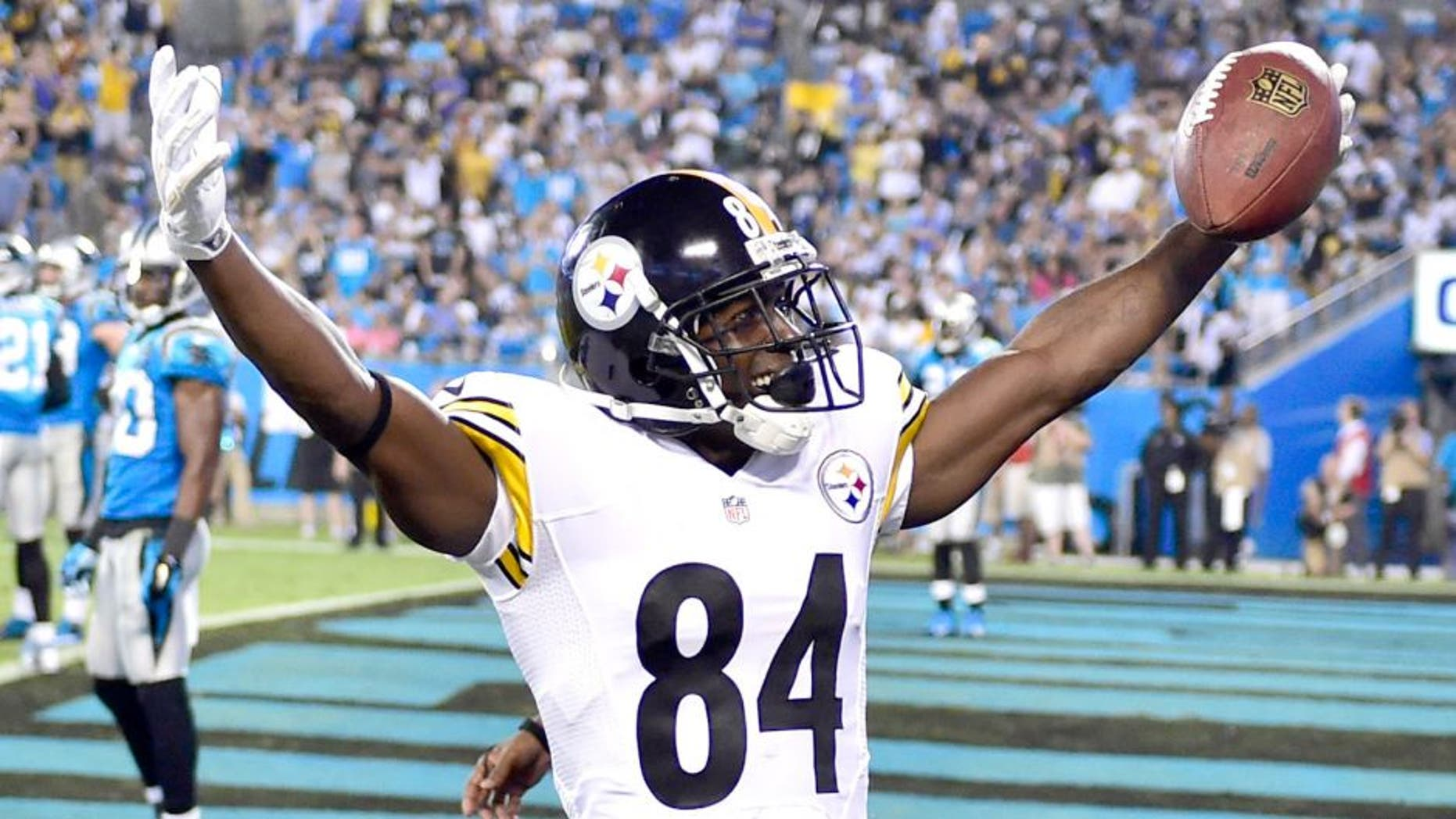 Sep 21, 2014; Charlotte, NC, USA; Pittsburgh Steelers wide receiver Antonio Brown (84) reacts after scoring a touchdown in the third quarter at Bank of America Stadium. Mandatory Credit: Bob Donnan-USA TODAY Sports