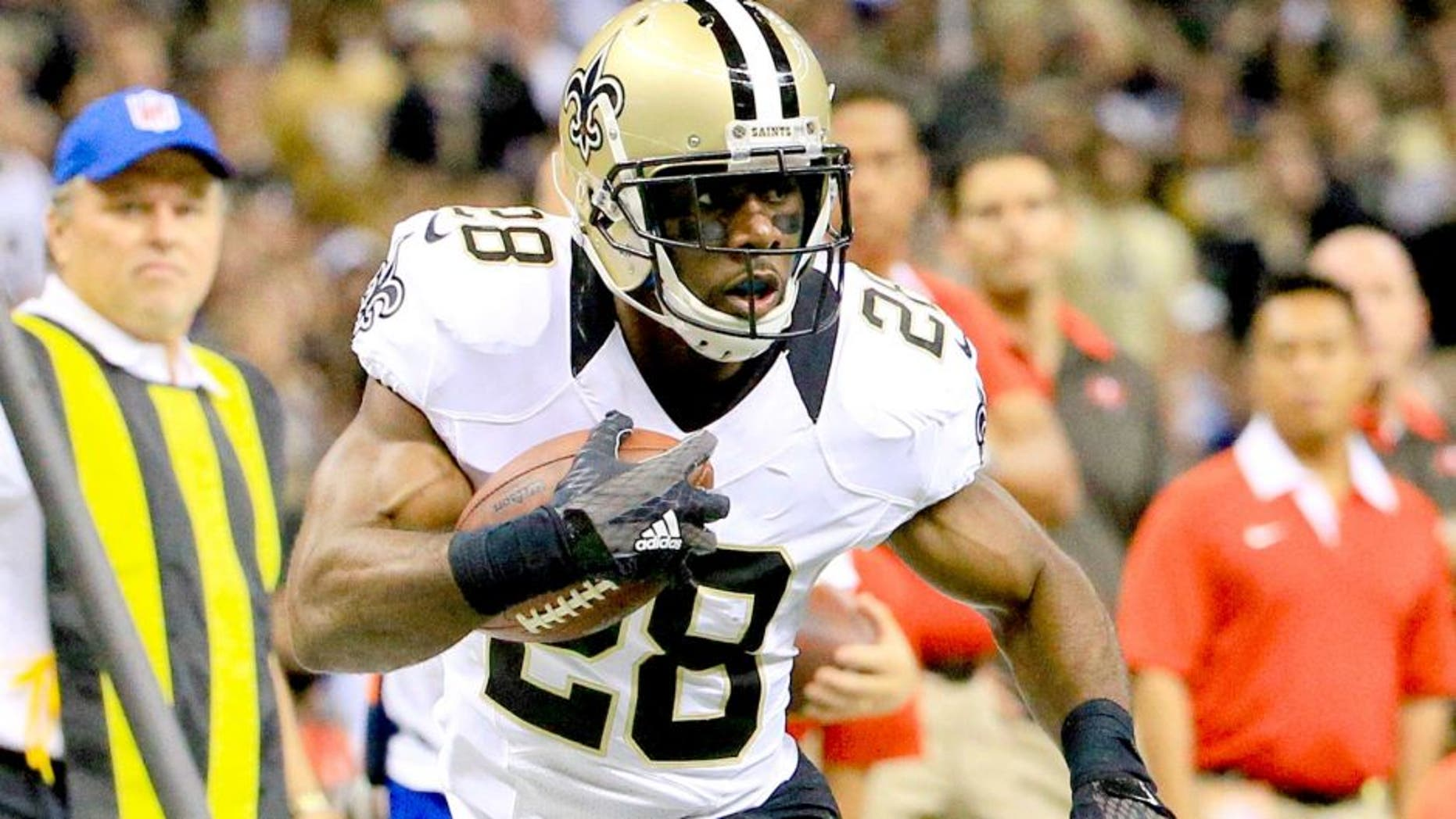 Sep 20, 2015; New Orleans, LA, USA; New Orleans Saints running back C.J. Spiller (28) carries the ball against the Tampa Bay Buccaneers during the second half of a game at the Mercedes-Benz Superdome. The Buccaneers won 26-19. Mandatory Credit: Derick E. Hingle-USA TODAY Sports