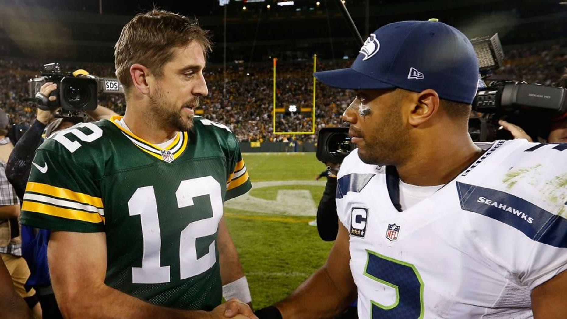 GREEN BAY, WI - SEPTEMBER 20: Quarterbacks Aaron Rodgers #12 of the Green Bay Packers and Russell Wilson #3 of the Seattle Seahawks shake hands following the NFL game at Lambeau Field on September 20, 2015 in Green Bay, Wisconsin. The Packers defeated the Seahawks 27-17. (Photo by Christian Petersen/Getty Images)