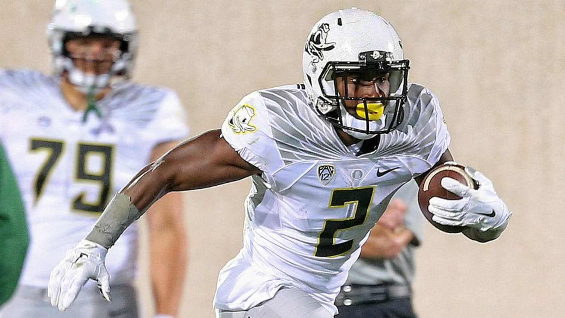 Sep 12, 2015; East Lansing, MI, USA; Oregon Ducks wide receiver Bralon Addison (2) runs for yards after a catch against the Michigan State Spartans during the 1st half of a game at Spartan Stadium. Mandatory Credit: Mike Carter-USA TODAY Sports