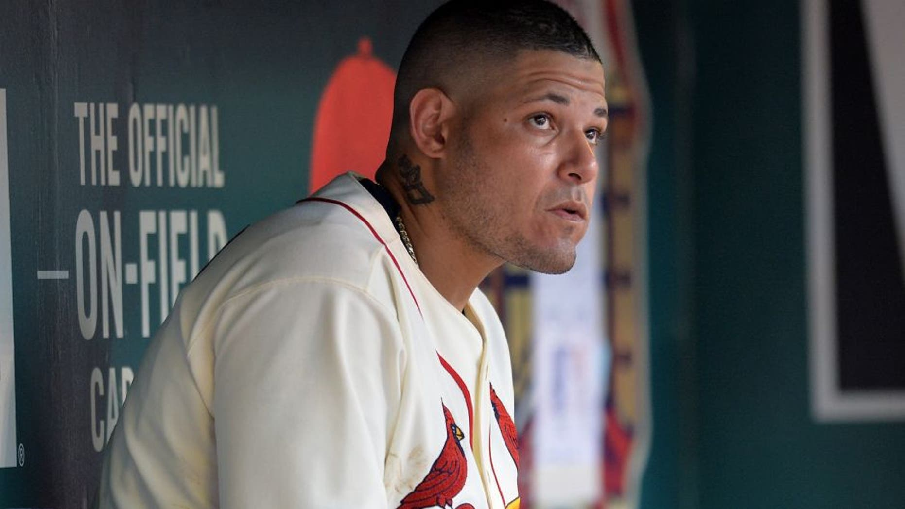 ST. LOUIS, MO - AUGUST 15: Yadier Molina #4 of the St. Louis Cardinals in the dugout during a game against the Miami Marlins at Busch Stadium on August 15, 2015 in St. Louis, Missouri. (Photo by Michael Thomas/Getty Images)