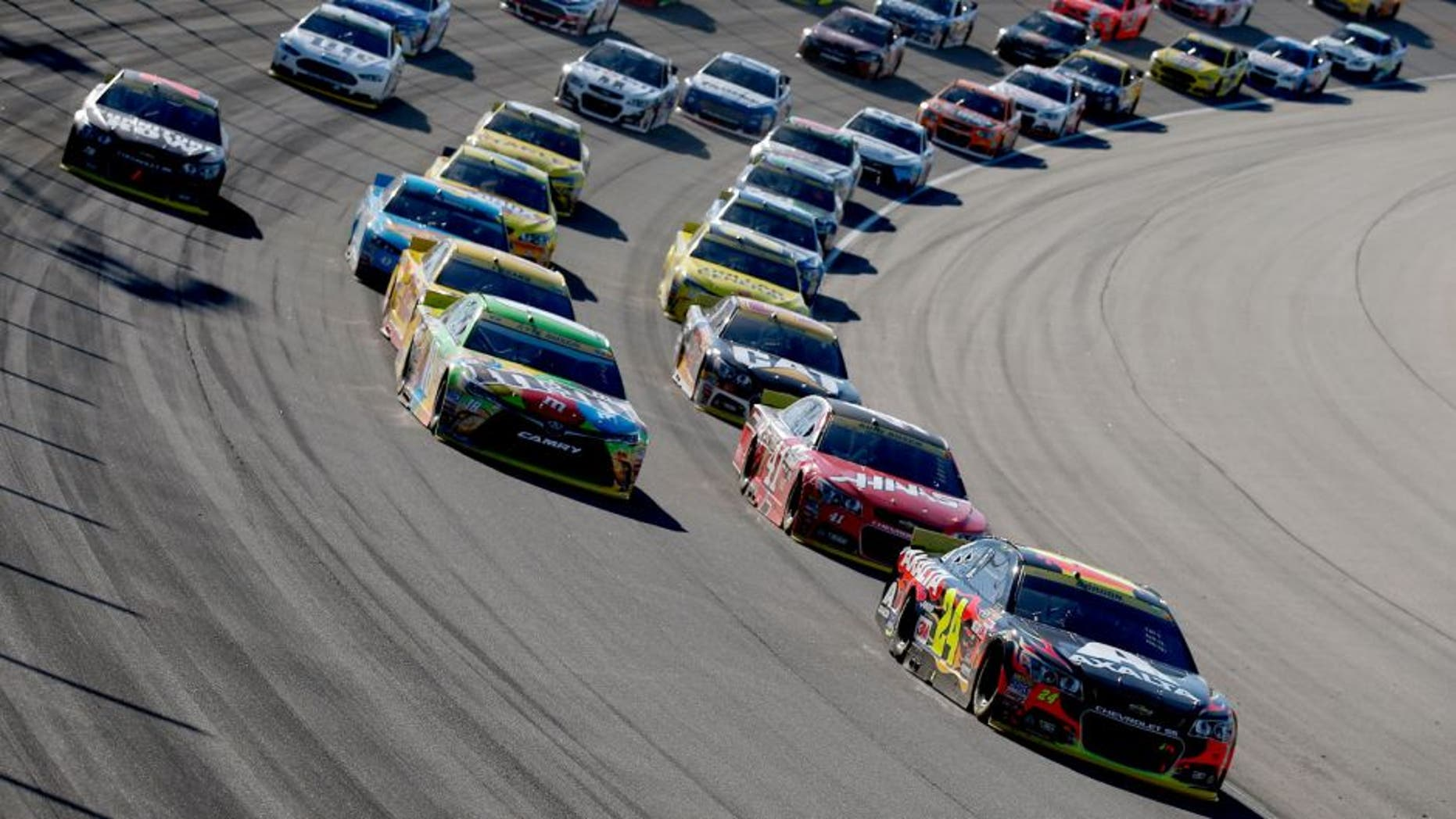 JOLIET, IL - SEPTEMBER 20: Jeff Gordon, driver of the #24 AXALTA Chevrolet, leads a pack of cars during the NASCAR Sprint Cup Series myAFibRisk.com 400 at Chicagoland Speedway on September 20, 2015 in Joliet, Illinois. (Photo by Todd Warshaw/NASCAR via Getty Images)