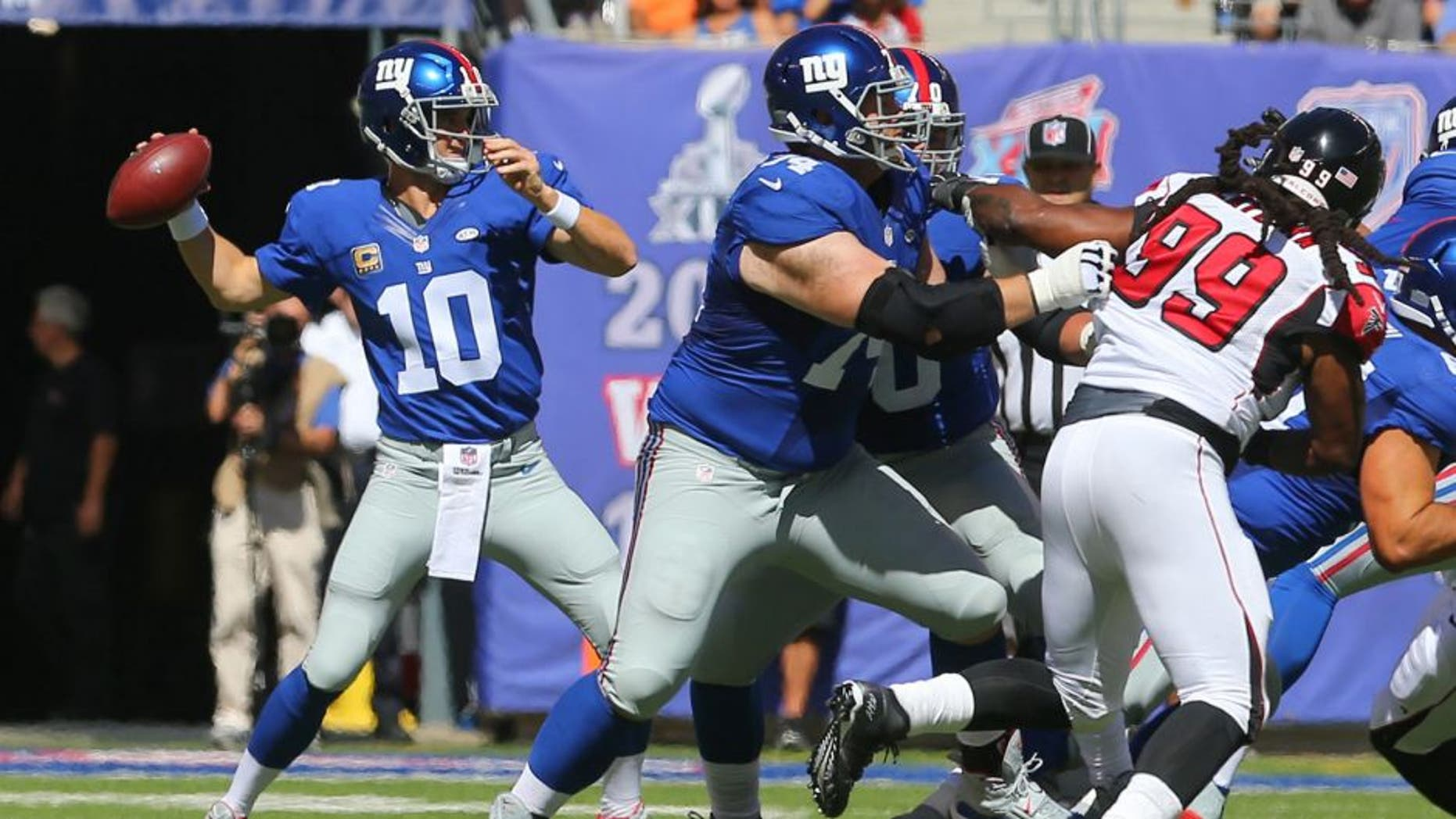 Sep 20, 2015; East Rutherford, NJ, USA; New York Giants quarterback Eli Manning (10) throws a pass during the first half of their game against the Atlanta Falcons at MetLife Stadium. Mandatory Credit: Ed Mulholland-USA TODAY Sports