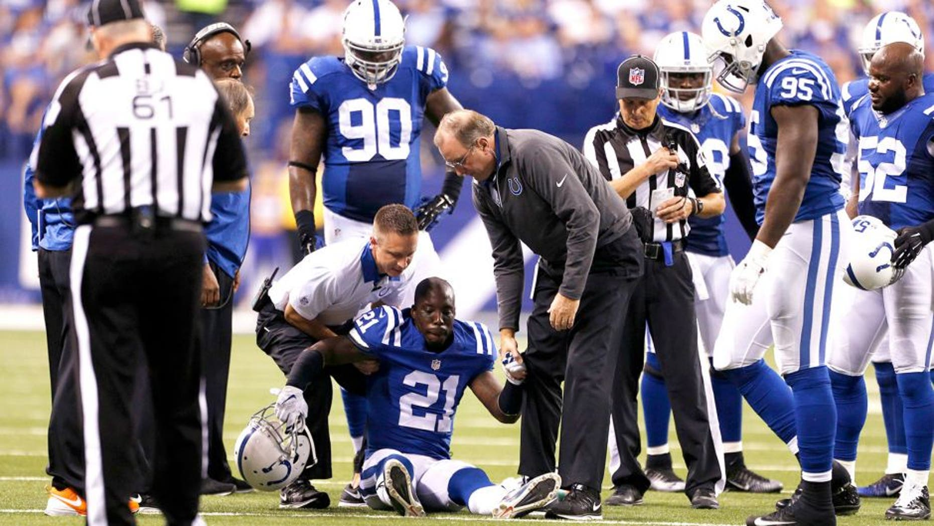 Sep 21, 2015; Indianapolis, IN, USA; Indianapolis Colts cornerback Vontae Davis (21) is helped off the ground after being hurt in a game against the New York Jets at Lucas Oil Stadium. Mandatory Credit: Brian Spurlock-USA TODAY Sports