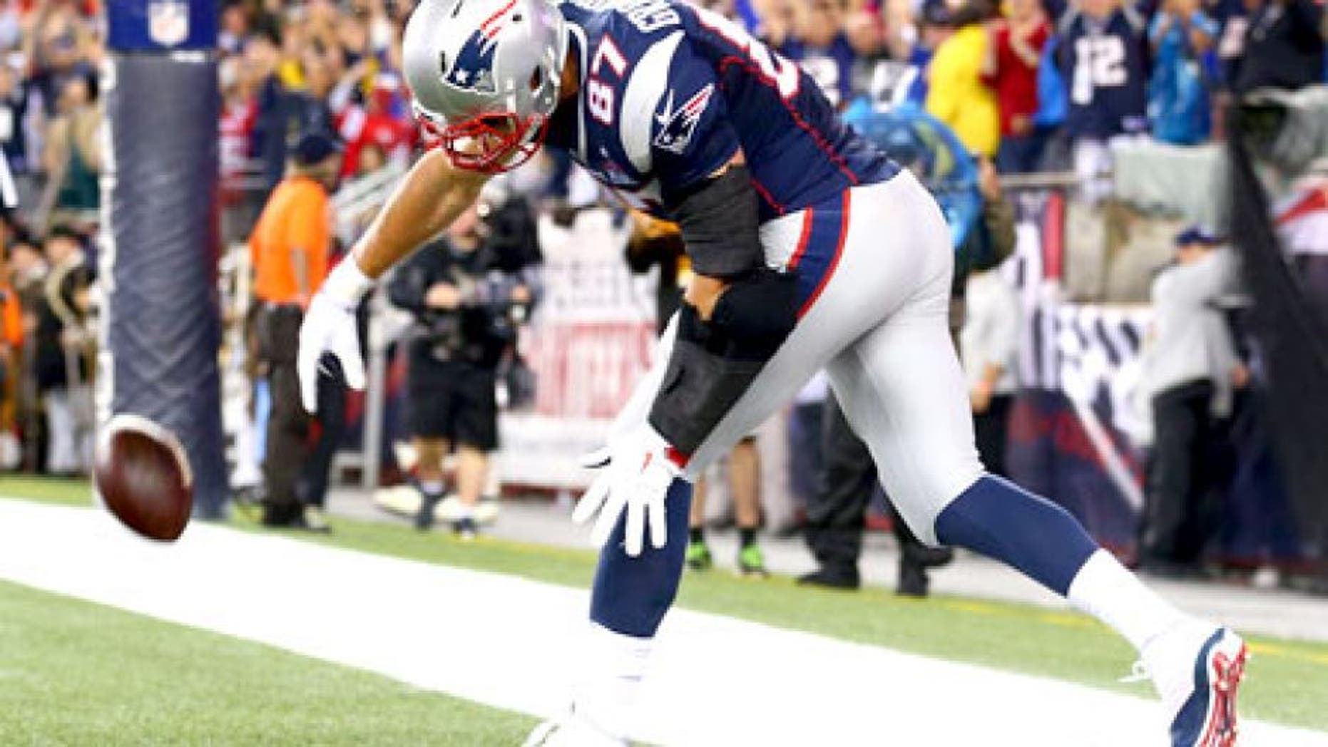 FOXBORO, MA - SEPTEMBER 10: Rob Gronkowski #87 of the New England Patriots spikes the ball to celebrate his touchdown in the second quarter against the Pittsburgh Steelers at Gillette Stadium on September 10, 2015 in Foxboro, Massachusetts. (Photo by Maddie Meyer/Getty Images)