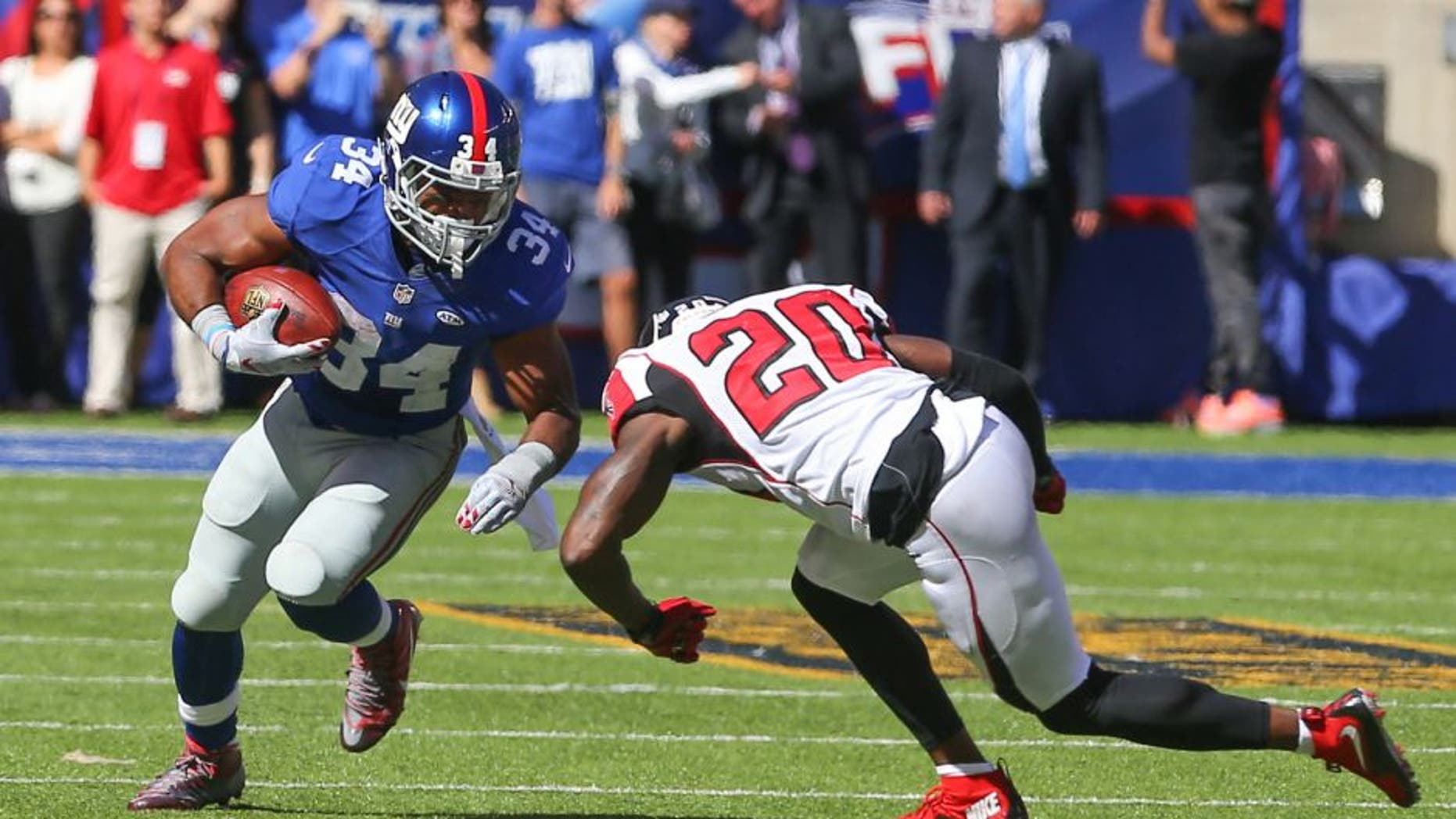 Sep 20, 2015; East Rutherford, NJ, USA; New York Giants running back Shane Vereen (34) runs with the ball while trying to avoid a tackle attempt by Atlanta Falcons defensive back Phillip Adams (20) during the first half at MetLife Stadium. Mandatory Credit: Ed Mulholland-USA TODAY Sports