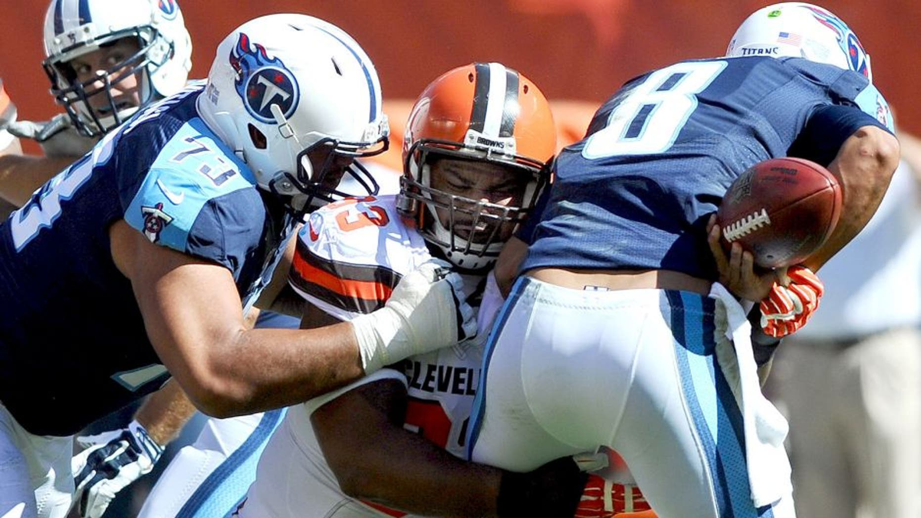 Sep 20, 2015; Cleveland, OH, USA; Cleveland Browns defensive end John Hughes (93) sacks Tennessee Titans quarterback Marcus Mariota (8) during the second half at FirstEnergy Stadium. The Browns won 28-14. Mandatory Credit: Ken Blaze-USA TODAY Sports