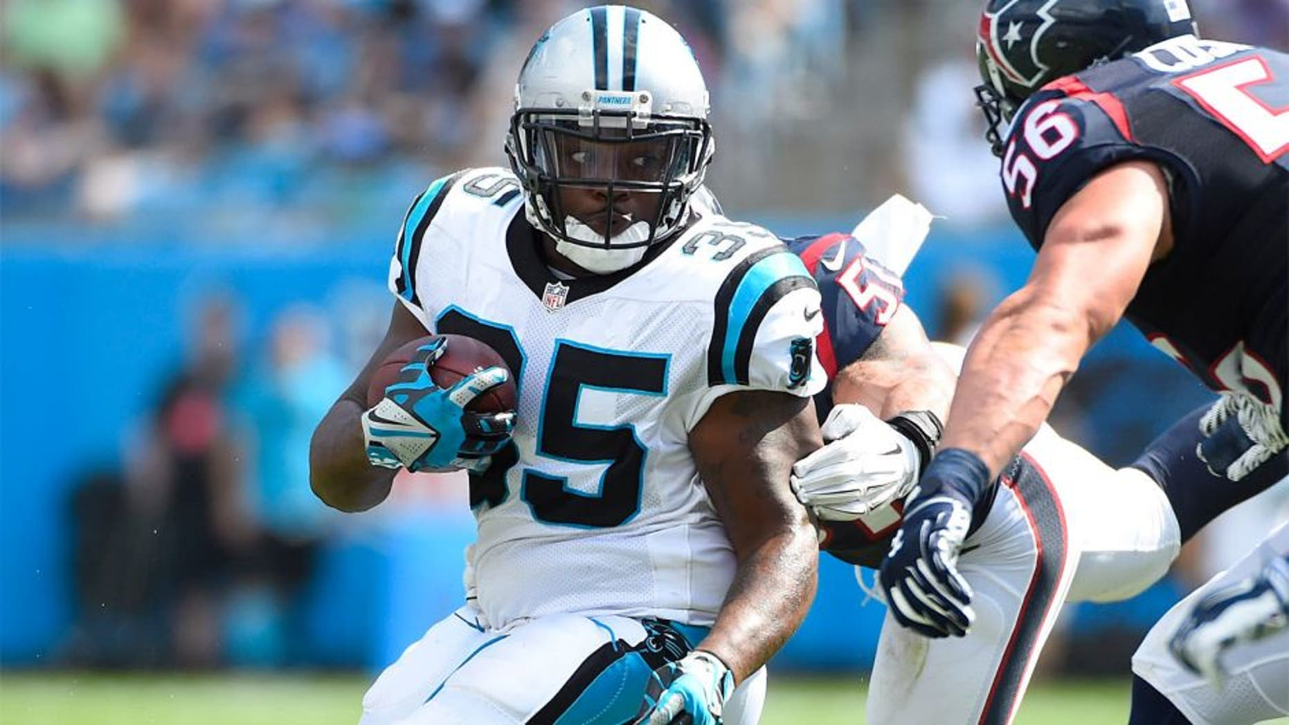 Sep 20, 2015; Charlotte, NC, USA; Carolina Panthers fullback Mike Tolbert (35) with the ball as Houston Texans outside linebacker John Simon (51) and inside linebacker Brian Cushing (56) defend in the third quarter. The Panthers defeated the Texans 24-17 at Bank of America Stadium. Mandatory Credit: Bob Donnan-USA TODAY Sports