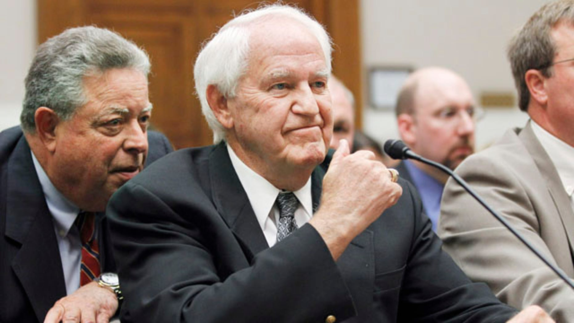 Sept. 22: Hillandale Farms of Iowa President Orland Bethel, right, confers with his lawyer on Capitol Hill in Washington.