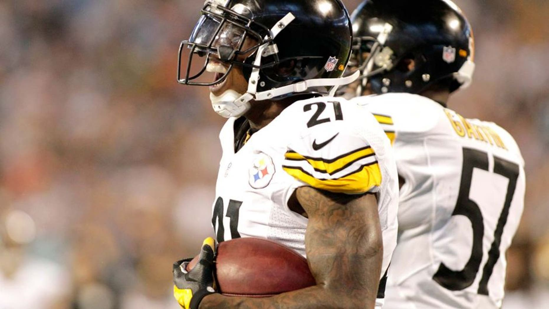 Pittsburgh Steelers' Robert Golden (21) reacts after recovering a muffed punt in the end zone for a touchdown against the Carolina Panthers during the second half of an NFL football game in Charlotte, N.C., Sunday, Sept. 21, 2014. (AP Photo/Bob Leverone)