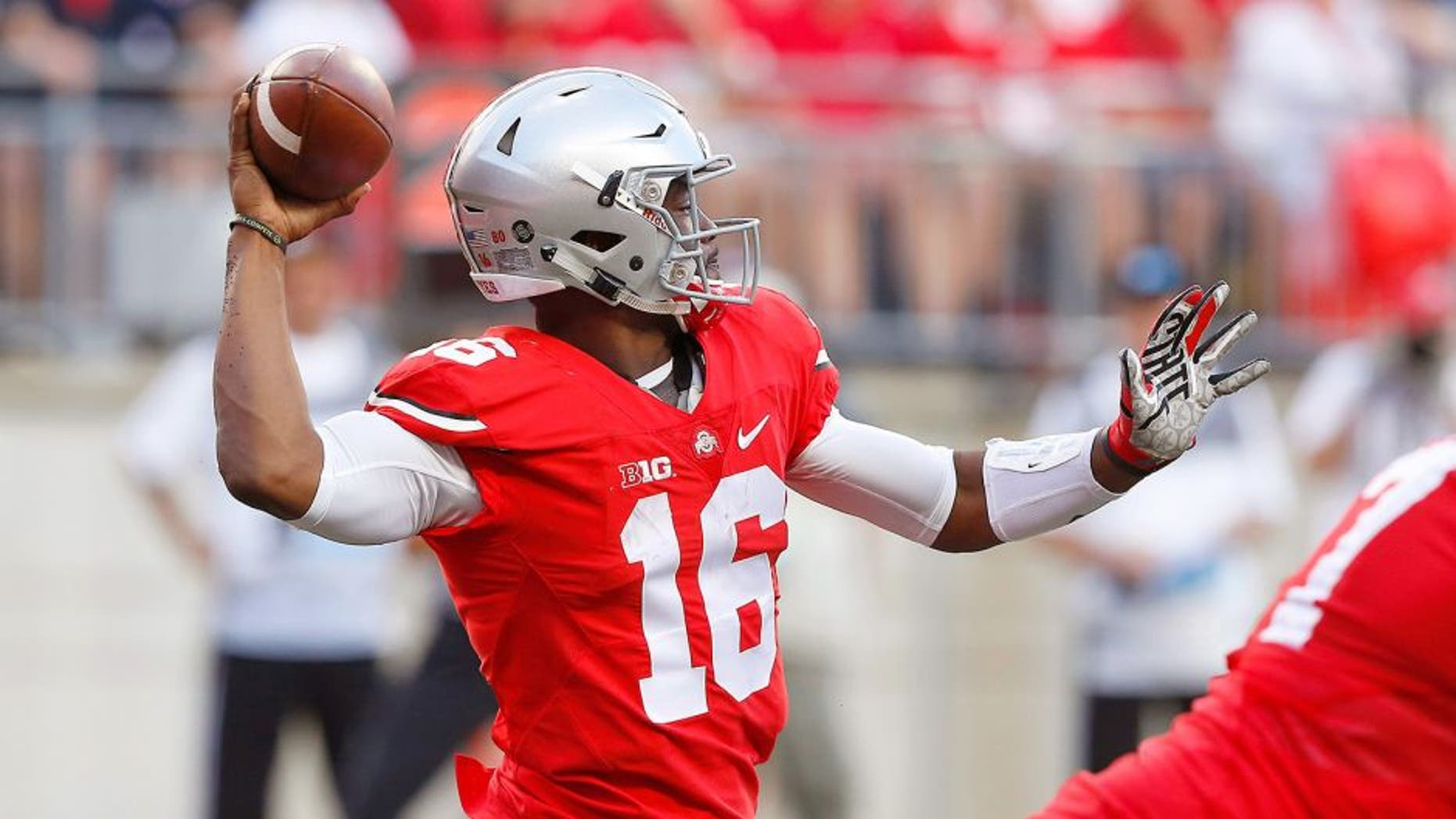Sep 19, 2015; Columbus, OH, USA; Ohio State Buckeyes quarterback J.T. Barrett (16) drops to throw during the second half versus the Northern Illinois Huskies at Ohio Stadium. The Ohio State Buckeyes won 20-13. Mandatory Credit: Joe Maiorana-USA TODAY Sports
