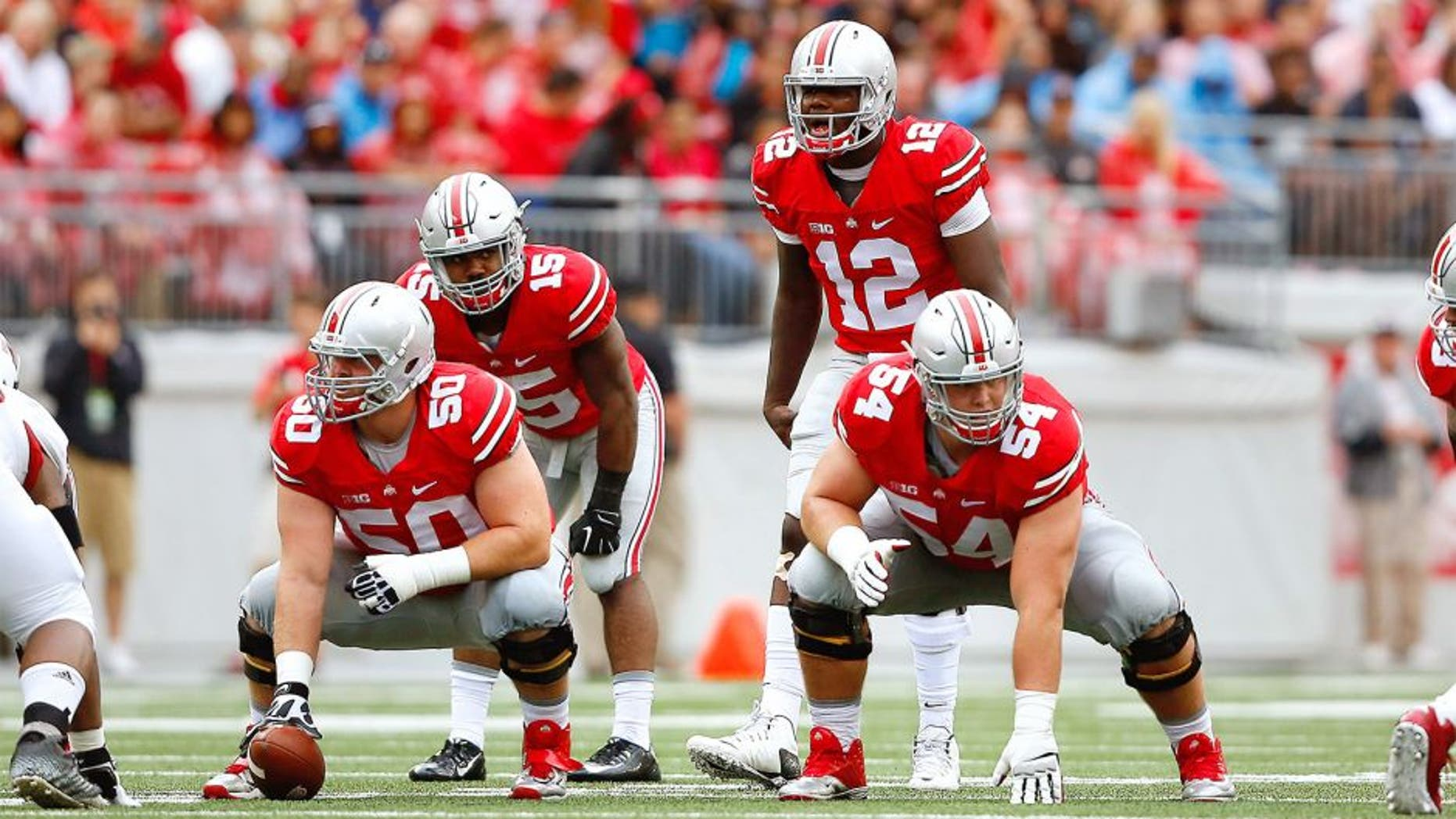 Sep 19, 2015; Columbus, OH, USA; Ohio State Buckeyes offensive lineman Jacoby Boren (50) and Billy Price (54) with Buckeyes quarterback Cardale Jones (12) and running back Ezekiel Elliott (15) in the backfield during the game versus the Northern Illinois Huskies at Ohio Stadium. Ohio State won the game 20-13. Mandatory Credit: Joe Maiorana-USA TODAY Sports