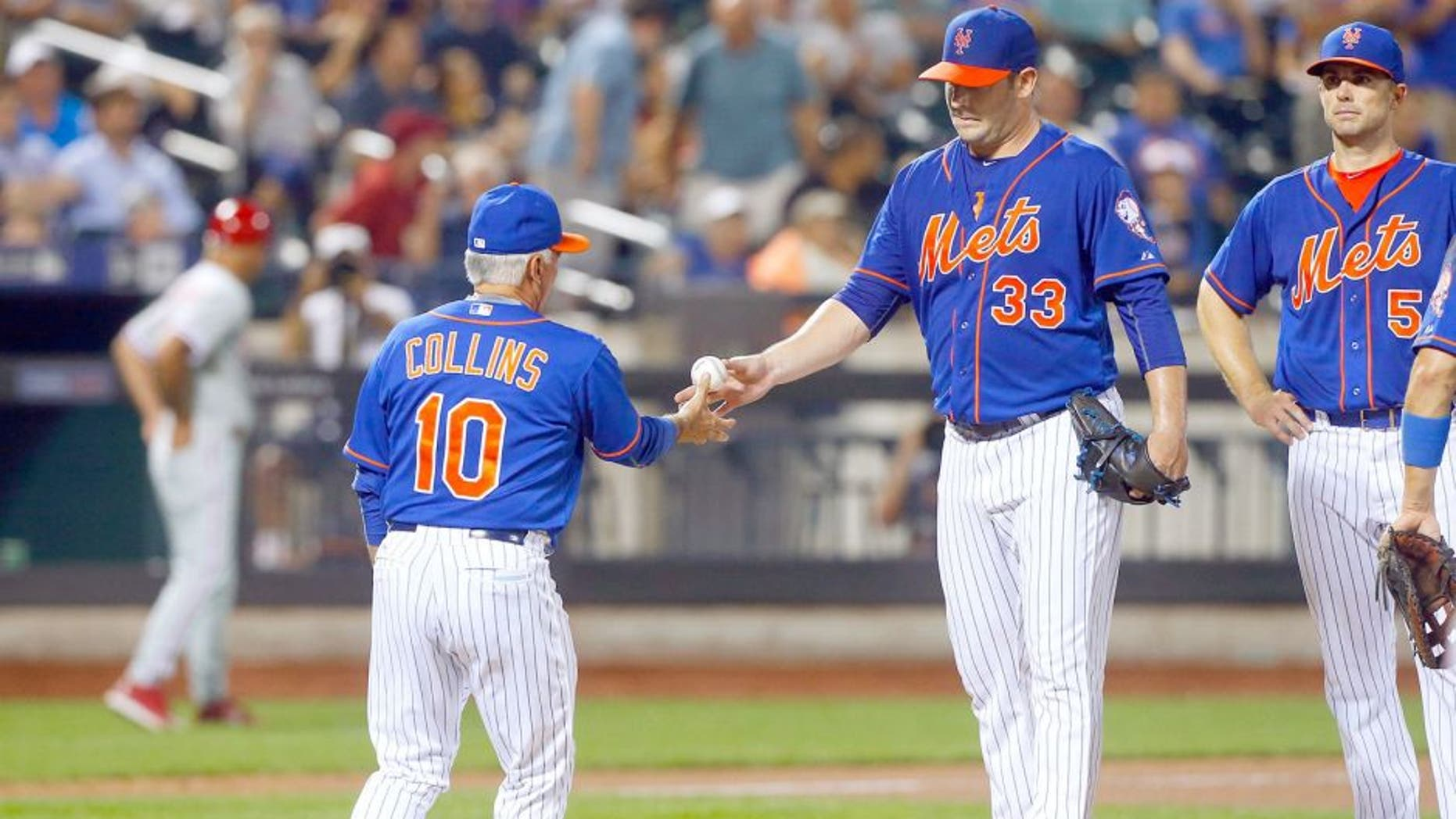 NEW YORK, NY - SEPTEMBER 02: Matt Harvey #33 of the New York Mets hands the ball to manager Terry Collins #10 against the Philadelphia Phillies at Citi Field on September 2, 2015 in the Flushing neighborhood of the Queens borough of New York City. The Mets defeated the Phillies 9-4. (Photo by Jim McIsaac/Getty Images)