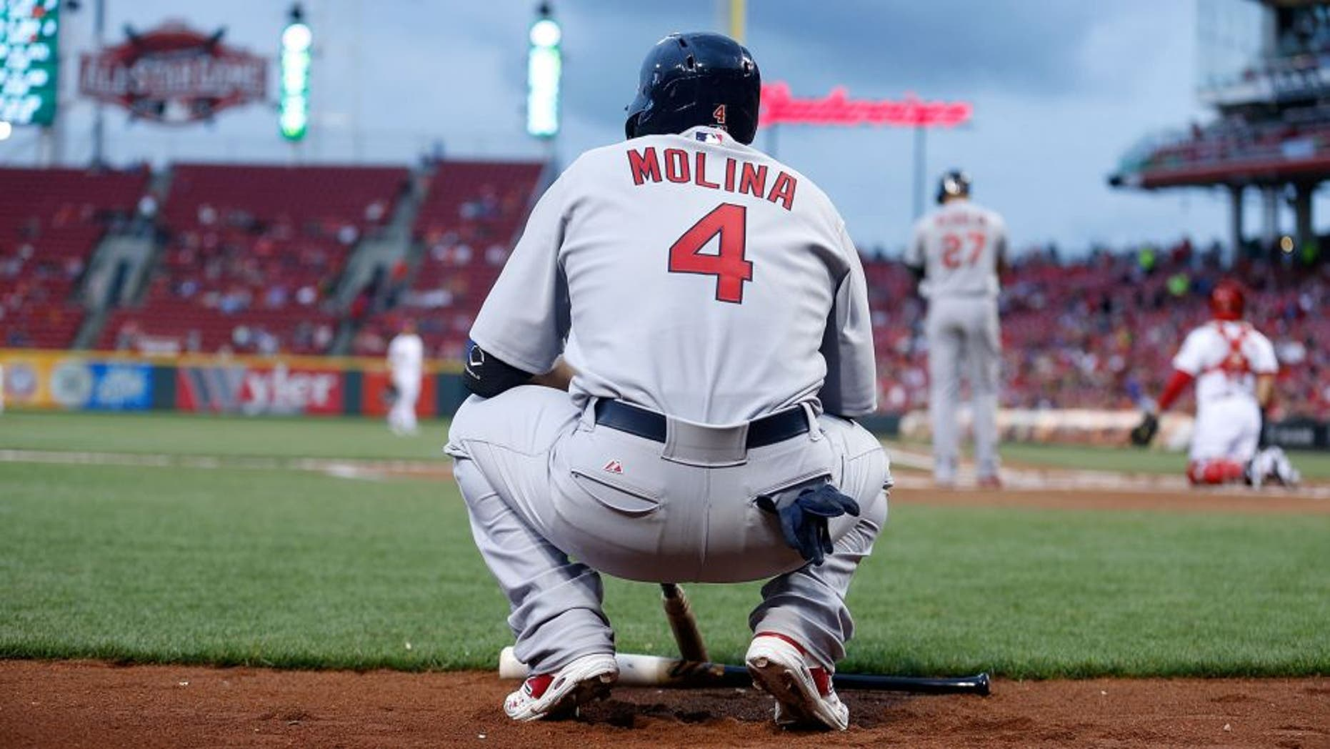 CINCINNATI, OH - SEPTEMBER 11: Yadier Molina #4 of the St. Louis Cardinals waits for his chance to bat during the game against the Cincinnati Reds at Great American Ball Park on September 11, 2015 in Cincinnati, Ohio. (Photo by Kirk Irwin/Getty Images)