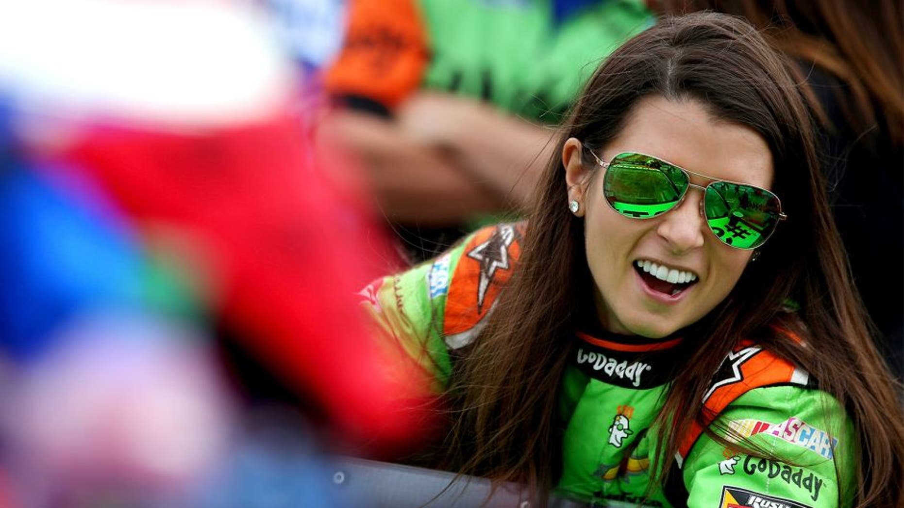 WATKINS GLEN, NY - AUGUST 08: Danica Patrick, driver of the #10 GoDaddy Chevrolet, stands on the grid during qualifying for the NASCAR Sprint Cup Series Cheez-It 355 at Watkins Glen International on August 8, 2015 in Watkins Glen, New York. (Photo by Sean Gardner/NASCAR via Getty Images)