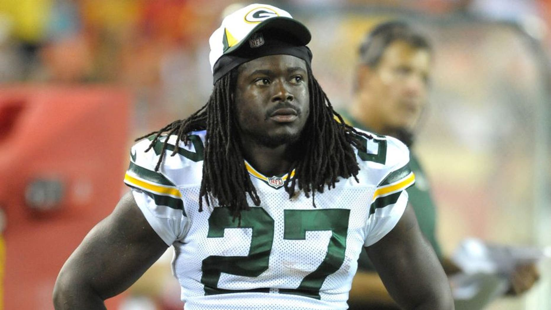 Aug 29, 2013; Kansas City, MO, USA; Green Bay Packers running back Eddie Lacy (27) watches play on the sidelines during the second half of the game against the Kansas City Chiefs at Arrowhead Stadium. The Chiefs won 30-8. Mandatory Credit: Denny Medley-USA TODAY Sports