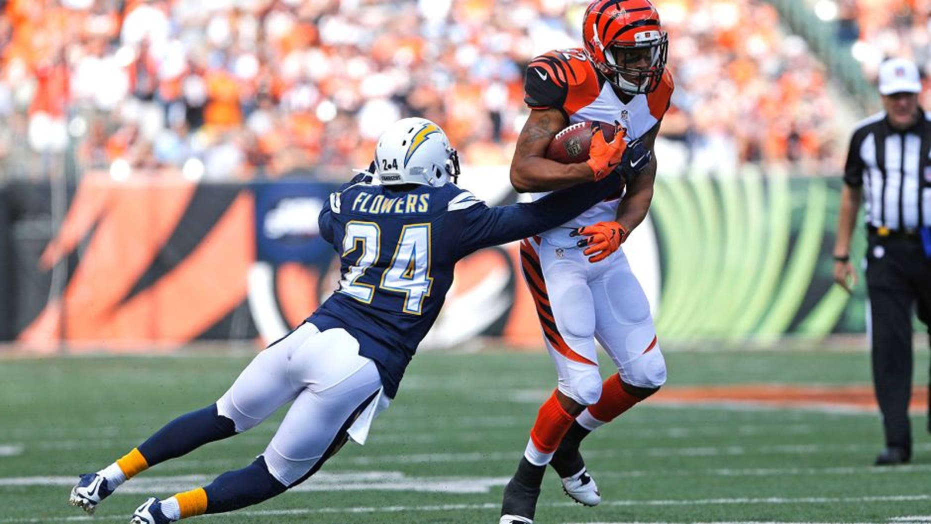Sep 20, 2015; Cincinnati, OH, USA; San Diego Chargers cornerback Brandon Flowers (24) attempts to tackle Cincinnati Bengals wide receiver Marvin Jones (82) in the first half at Paul Brown Stadium. The Bengals won 24-19. Mandatory Credit: Aaron Doster-USA TODAY Sports