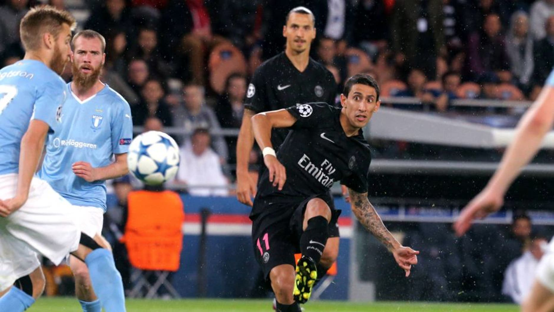 PARIS, FRANCE - SEPTEMBER 15: Angel Di Maria of Paris Saint-Germain in action with Zlatan Ibrahimovic during the UEFA Champions League between Paris Saint-Germain and Malmo FF at Parc Des Princes on September 15, 2015 in Paris, France. (Photo by Xavier Laine/Getty Images)