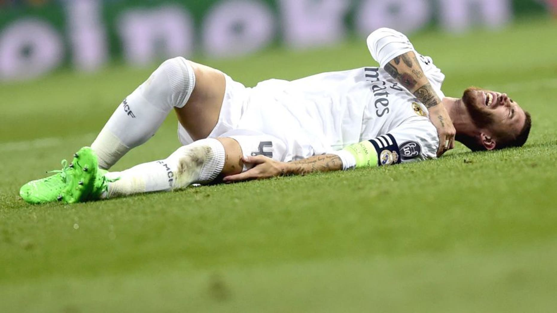 Real Madrid's defender Sergio Ramos complains on the ground during the UEFA Champions League group A football match Real Madrid CF vs FC Shakhtar Donetsk at the Santiago Bernabeu stadium in Madrid on September 15, 2015. AFP PHOTO/ JAVIER SORIANO (Photo credit should read JAVIER SORIANO/AFP/Getty Images)