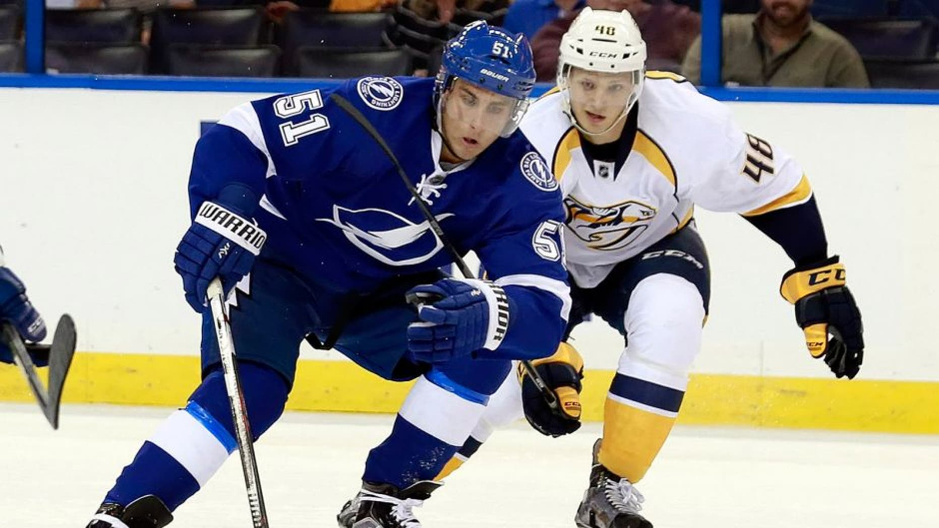 Sep 22, 2015; Tampa, FL, USA; Tampa Bay Lightning center Valtteri Filppula (51) skates with the puck as Nashville Predators defenseman Kristian Nakyva (48) defends during the second period at Amalie Arena. Mandatory Credit: Kim Klement-USA TODAY Sports