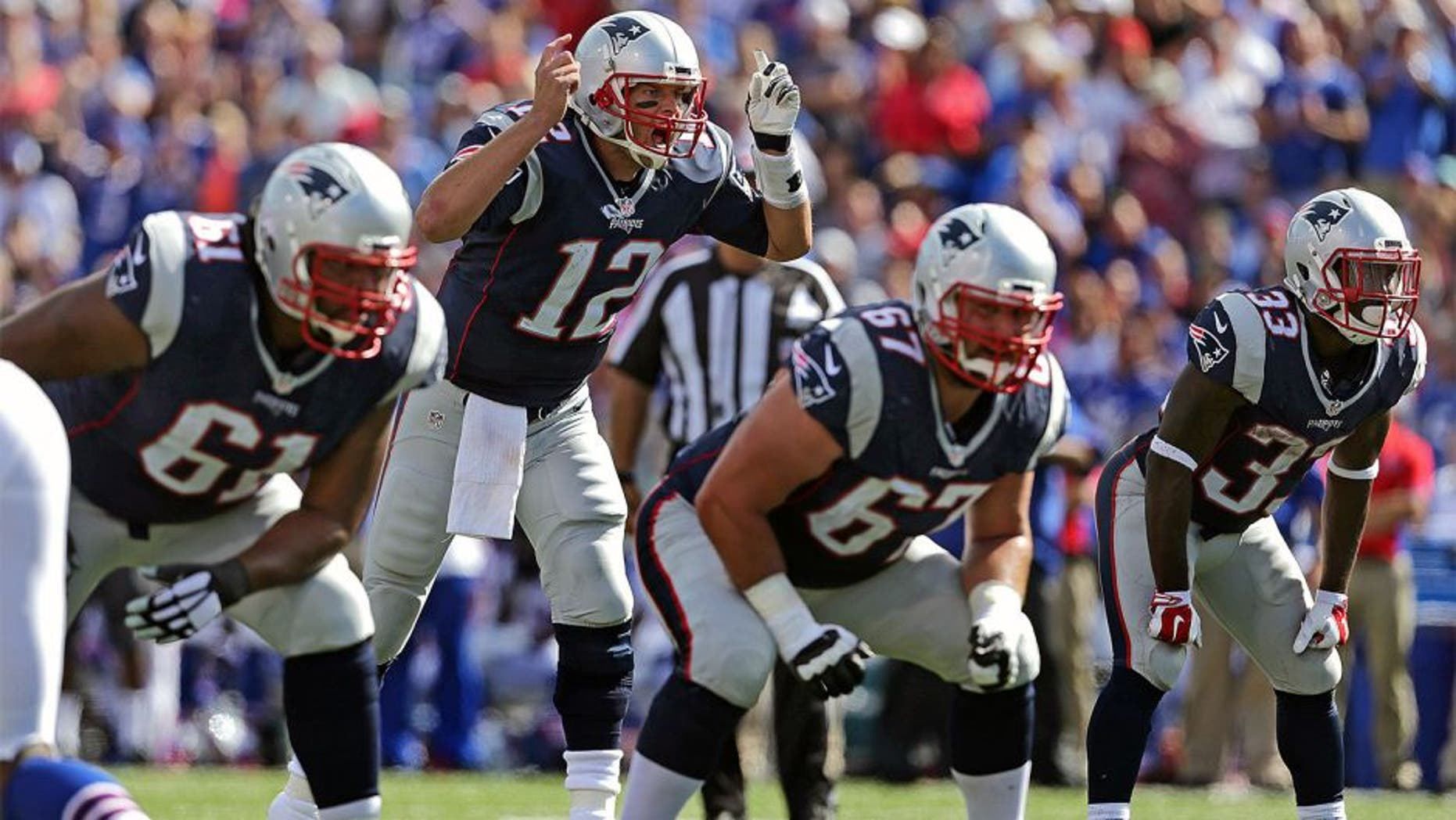 ORCHARD PARK, NY - SEPTEMBER 20: New England Patriots quarterback Tom Brady (#12) shouts out a play to his Offensive Line which kept him well protected against the vaunted Buffalo Bills defense. The New England Patriots take on the Buffalo Bills at Ralph Wilson Stadium in Orchard Park, New York, Sept. 20, 2015. (Photo by Barry Chin/The Boston Globe via Getty Images)