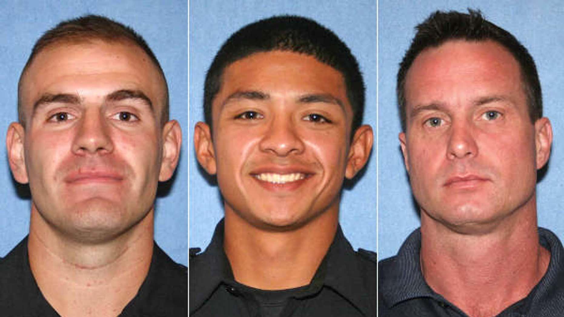 Phoenix officers left to right: Michael J. Carnicle, Richard G. Pina and Jason E. McFadden.