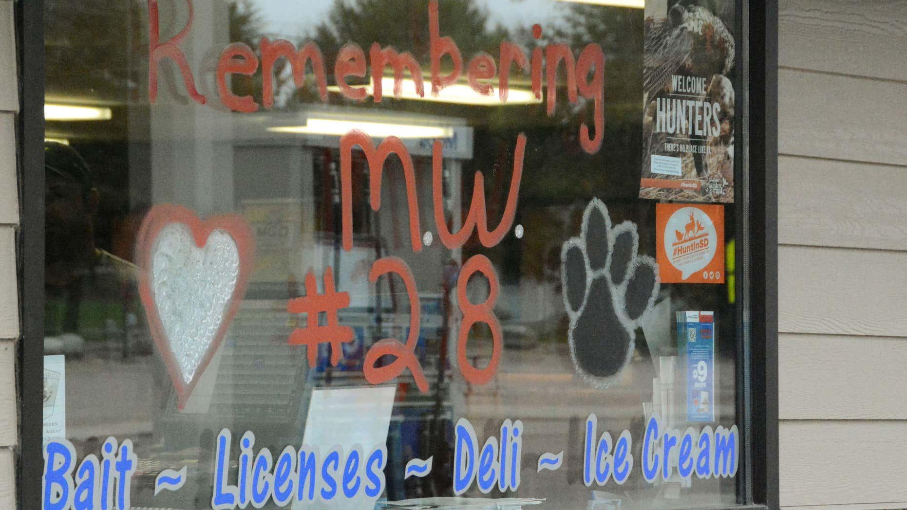 Sept. 22, 2015: A convenience store window memorializes high school sophomore Michael Westerhuis in Platte, S.D.