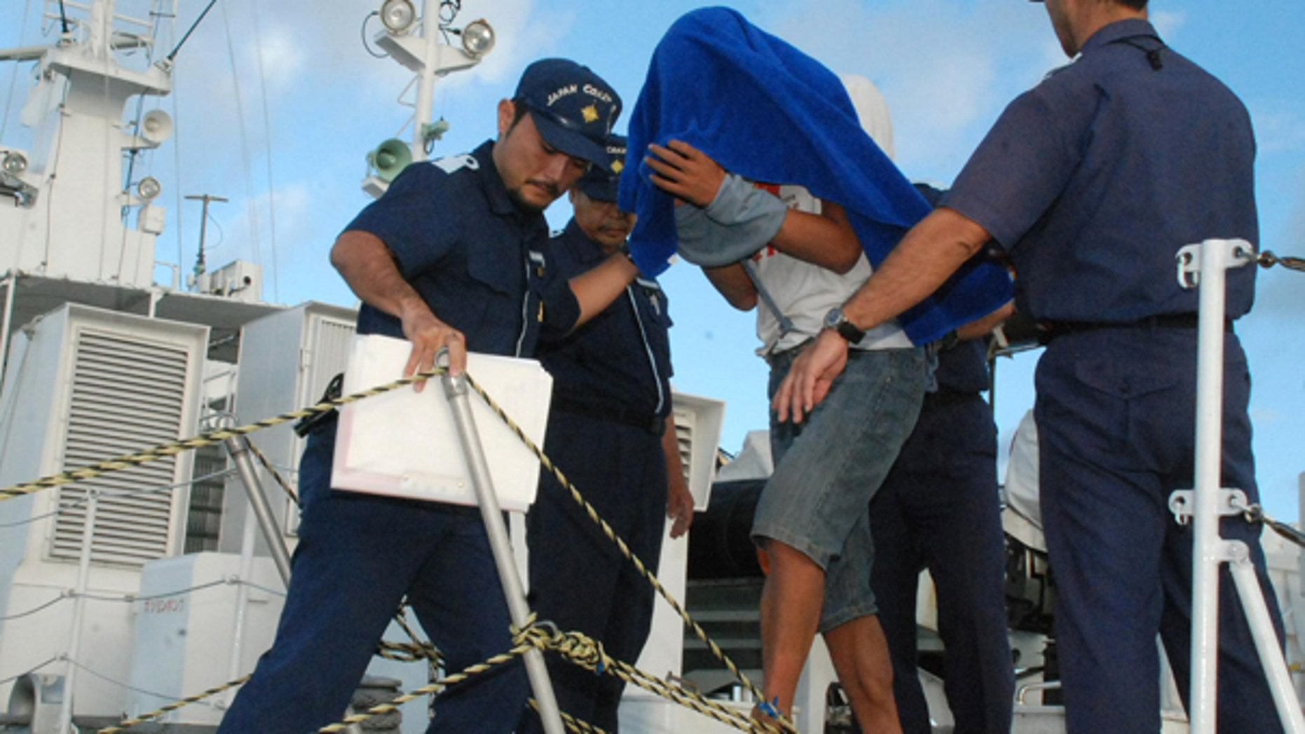 Sept. 8: Japan Coast Guard personnel disembark Zhan Qixiong, the 41-year-old Chinese captain of a Chinese fishing boat, center, at a port on Ishigaki island. The boat collided with two Japanese patrol vessels near disputed islands causing more than 2 weeks of strained relations between the two countries, before Japan announced the captain's release.