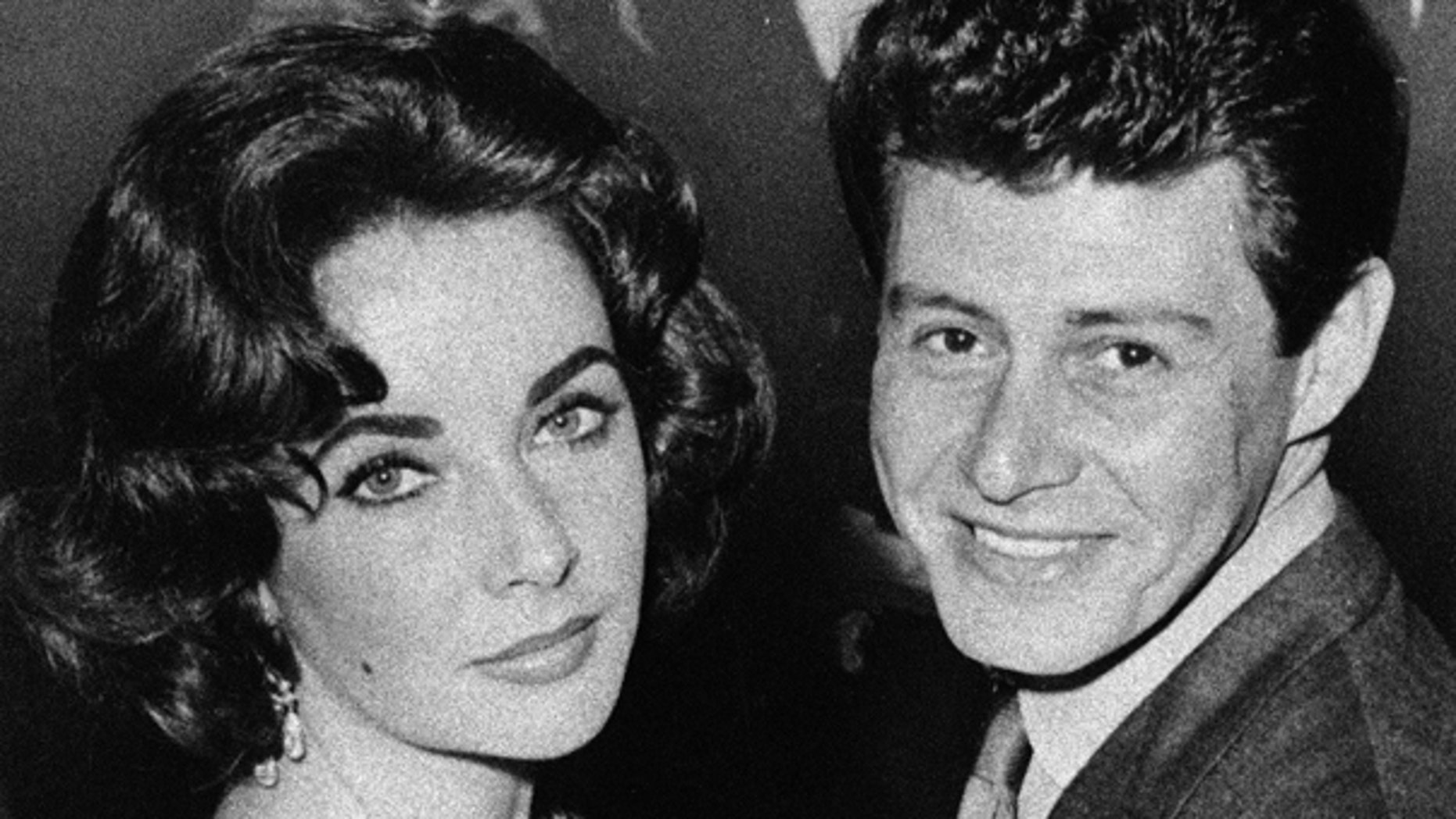 In this 1959 file photo, actress Elizabeth Taylor is seen with singer Eddie Fisher before their marriage. Fisher, whose huge fame as a pop singer was overshadowed by scandals ending his marriages to Debbie Reynolds and Taylor, died Wednesday night, Sept. 22, of complications from hip surgery at a hospital in Berkeley.