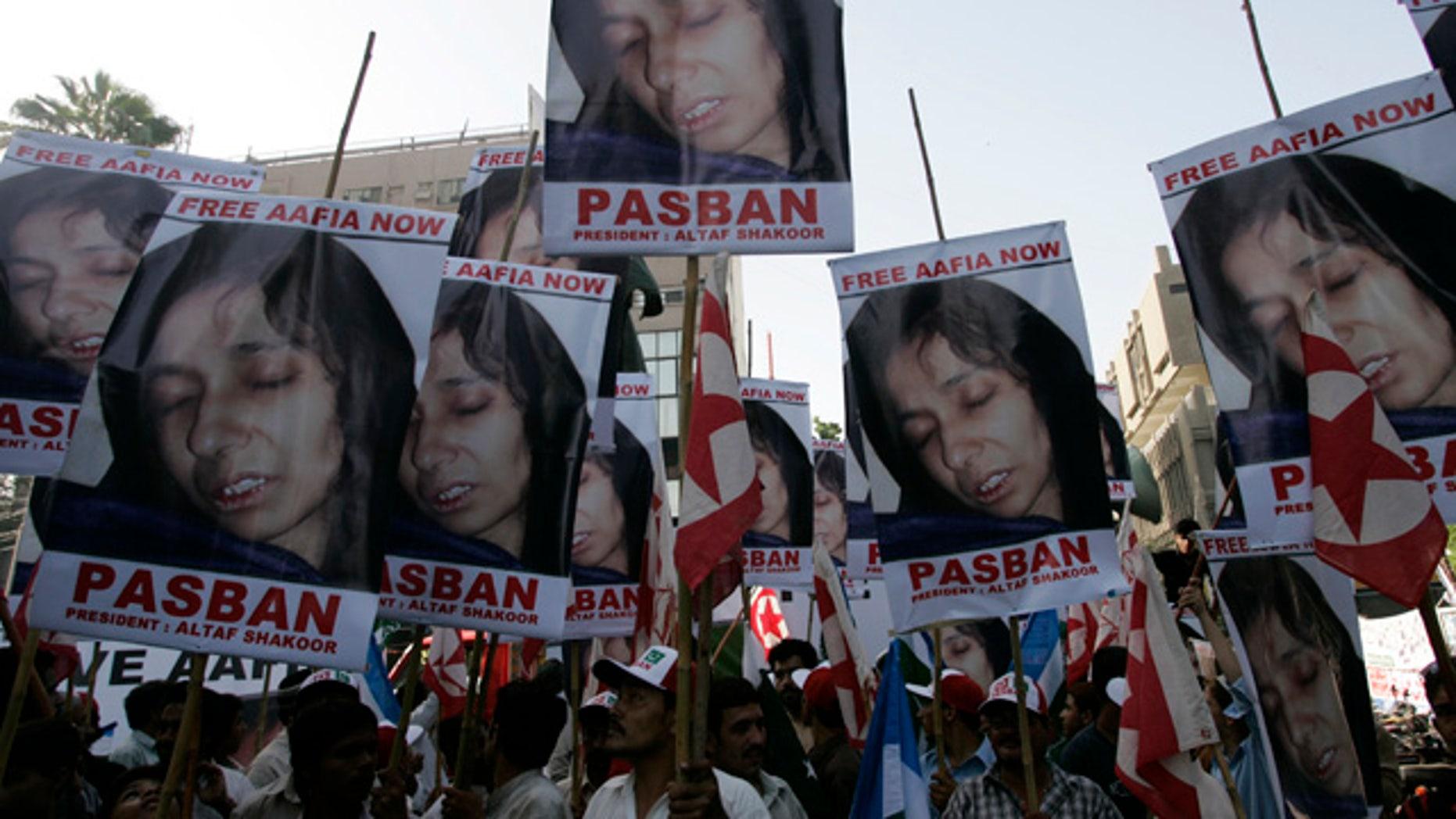 Sept. 23: Pakistani protesters rally near to condemn the arrest of alleged Al Qaeda suspect Aafia Siddiqui.