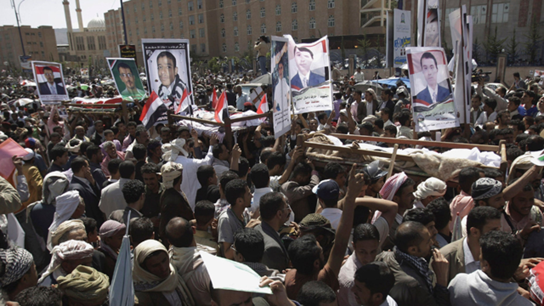 Sept. 21: Anti-government protestors carry the bodies of Yemeni men who were killed in the recent clashes with security forces, during their funeral procession in Sanaa, Yemen.