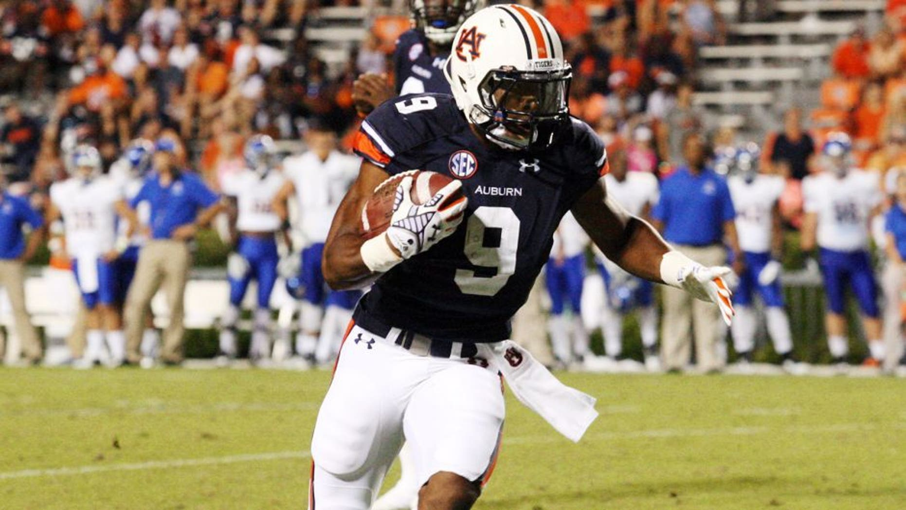 Sep 6, 2014; Auburn, AL, USA; Auburn Tigers running back Roc Thomas (9) carries against the San Jose State Spartans during the second half at Jordan Hare Stadium. The Tigers beat the Spartans 59-13. Mandatory Credit: John Reed-USA TODAY Sports