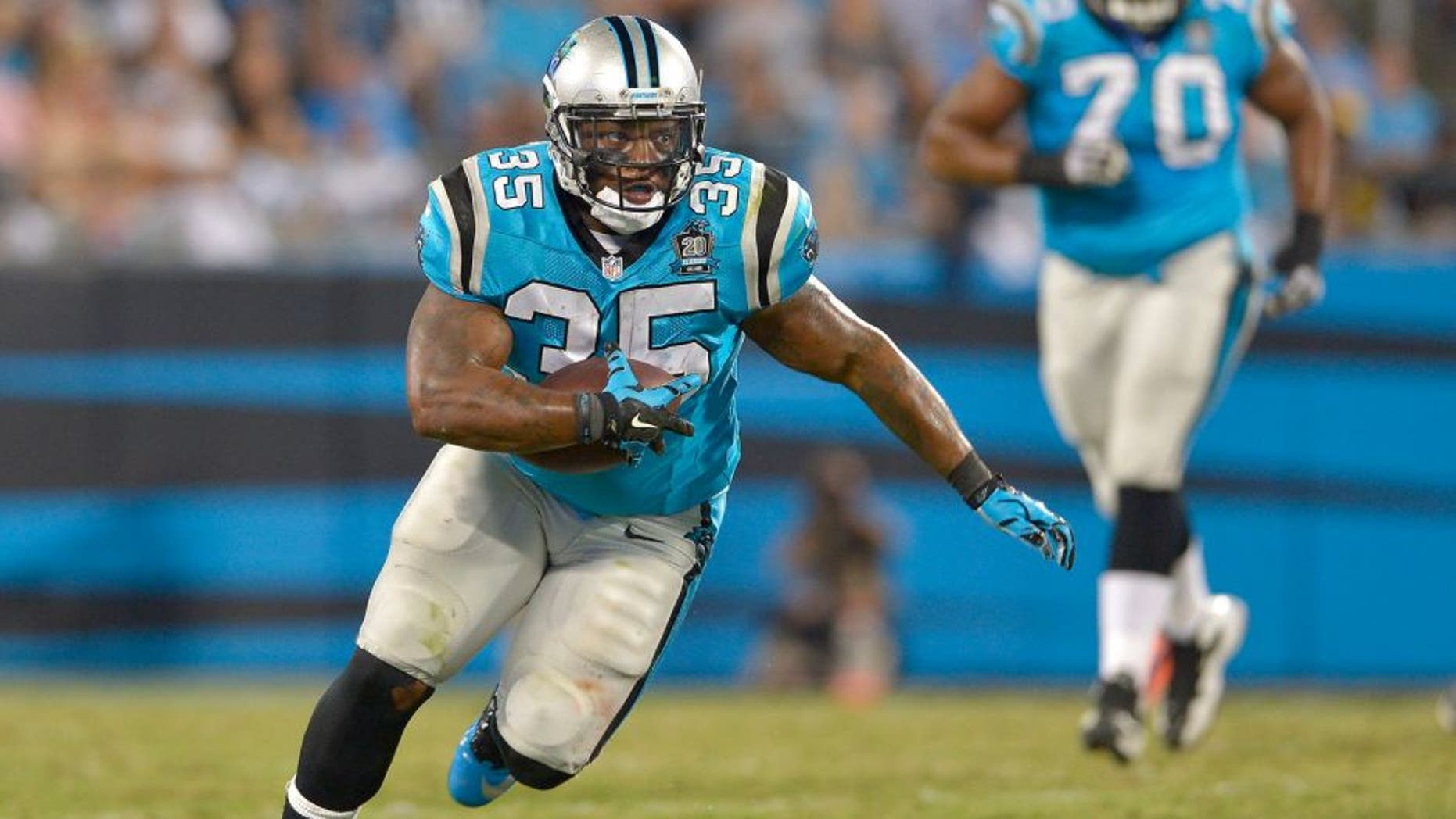 CHARLOTTE, NC - SEPTEMBER 21: Mike Tolbert #35 of the Carolina Panthers runs against the Pittsburgh Steelers during their game at Bank of America Stadium on September 21, 2014 in Charlotte, North Carolina. The Steelers won 37-19. (Photo by Grant Halverson/Getty Images) *** Local Caption *** Mike Tolbert
