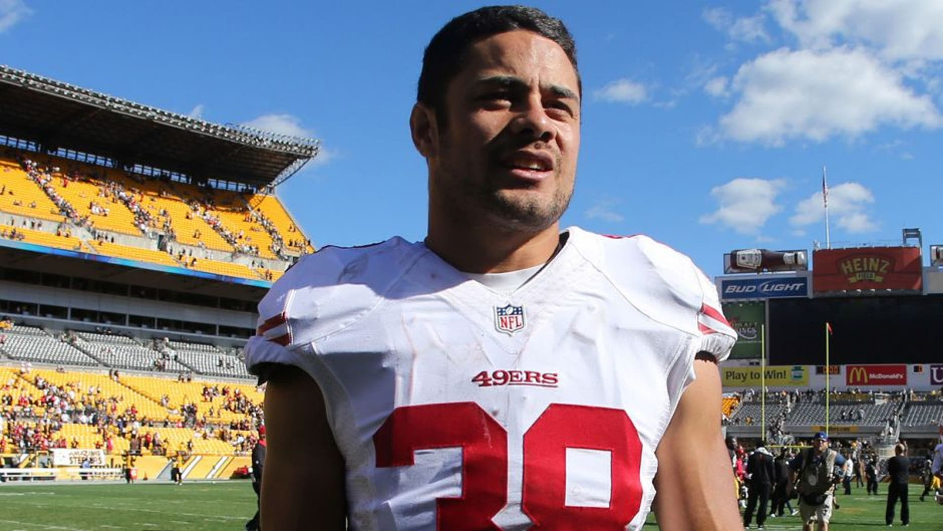 Sep 20, 2015; Pittsburgh, PA, USA; San Francisco 49ers running back Jarryd Hayne (38) walks off the field after playing the Pittsburgh Steelers at Heinz Field. The Steelers won 43-18. Mandatory Credit: Charles LeClaire-USA TODAY Sports