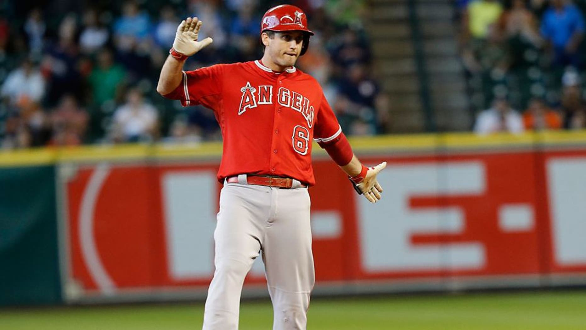 Sep 23, 2015; Houston, TX, USA; Los Angeles Angels third baseman David Freese (6) reacts after hitting a two run RBI double against the Houston Astros in the eighth inning at Minute Maid Park. Mandatory Credit: Thomas B. Shea-USA TODAY Sports