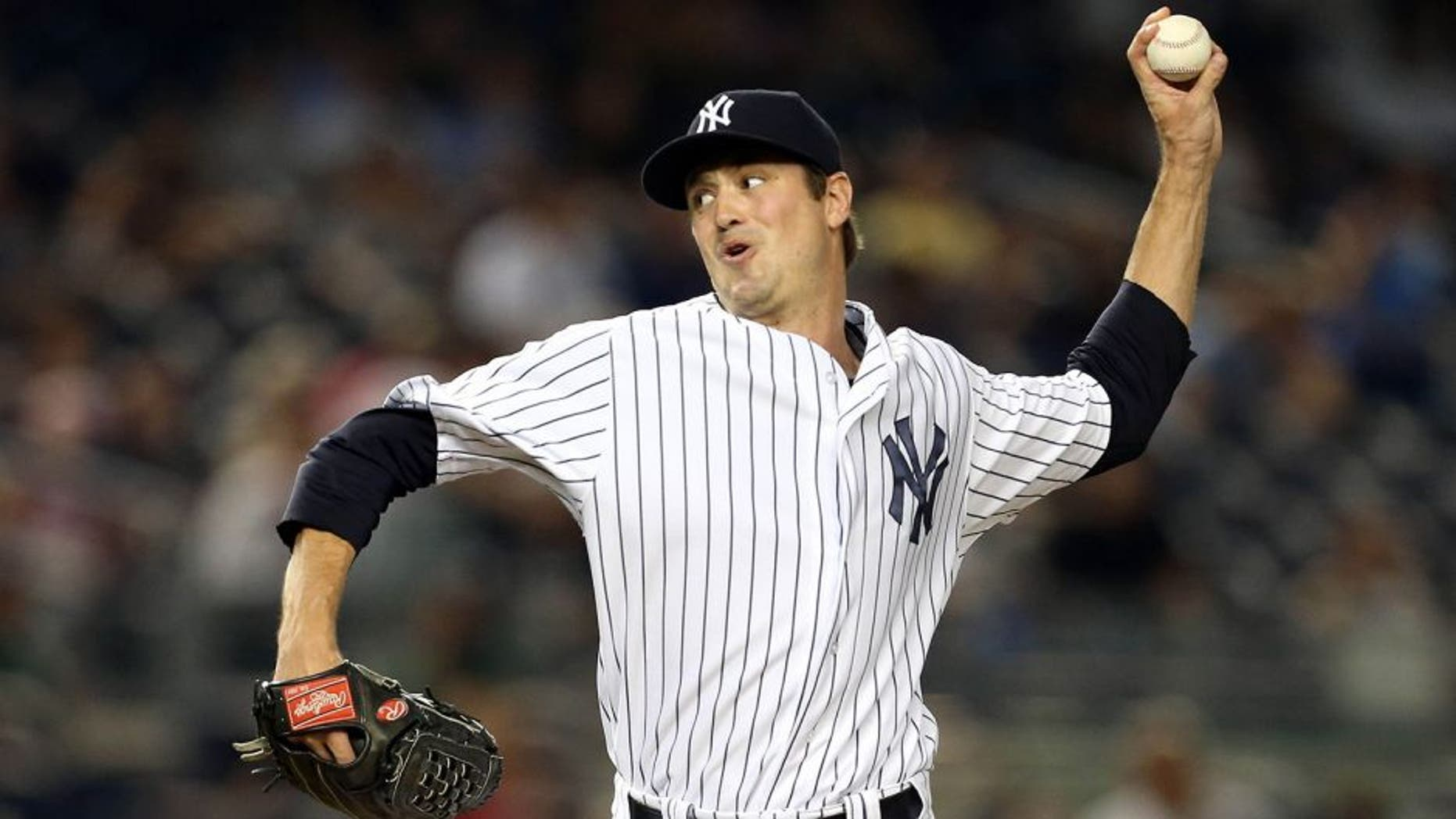 Aug 17, 2015; Bronx, NY, USA; New York Yankees relief pitcher Andrew Miller (48) pitches against the Minnesota Twins during the tenth inning at Yankee Stadium. The Yankees defeated the Twins 8 - 7. Mandatory Credit: Adam Hunger-USA TODAY Sports