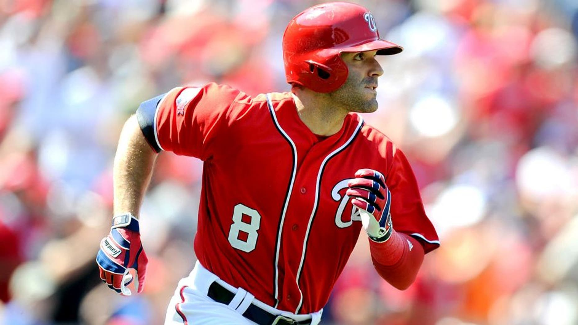 WASHINGTON, DC - AUGUST 23: Danny Espinosa #8 of the Washington Nationals watches his three-run double in the third inning against the Milwaukee Brewers at Nationals Park on August 23, 2015 in Washington, DC. (Photo by Greg Fiume/Getty Images)