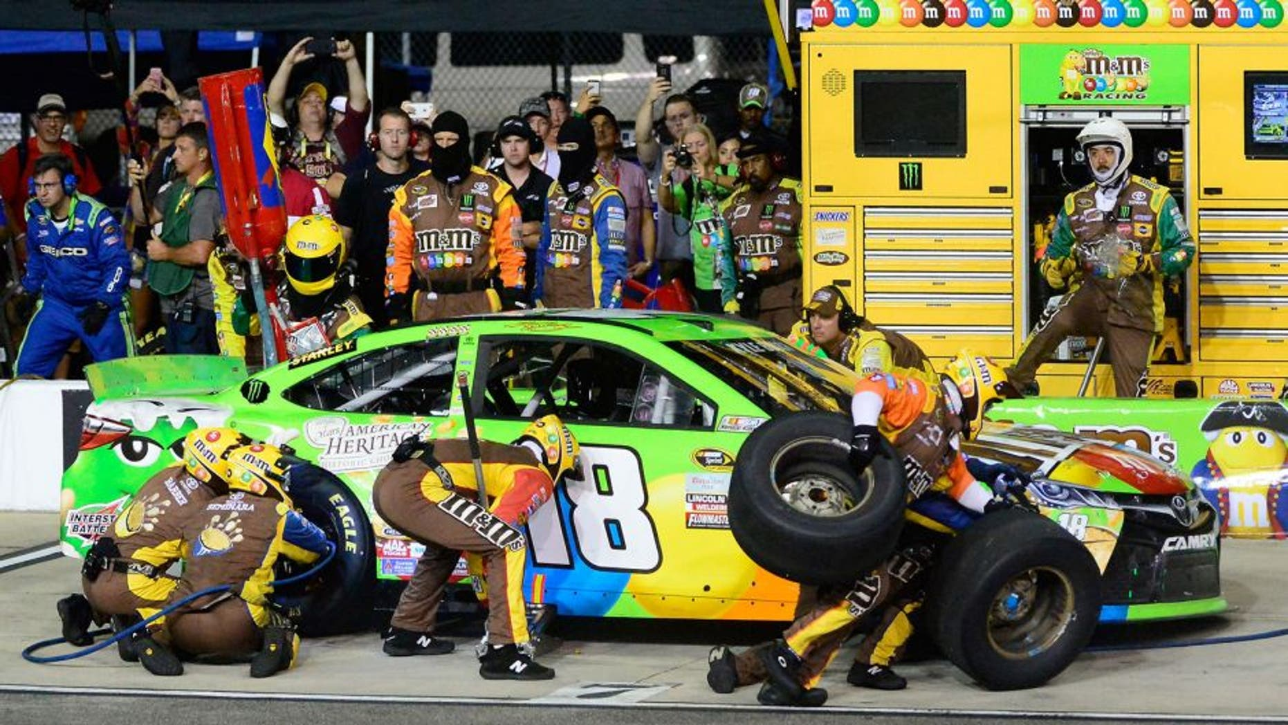 RICHMOND, VA - SEPTEMBER 12: Kyle Busch, driver of the #18 M&M's Crispy/American Heritage Chocolate Toyota, pits during the NASCAR Sprint Cup Series Federated Auto Parts 400 at Richmond International Raceway on September 12, 2015 in Richmond, Virginia. (Photo by Robert Laberge/Getty Images)