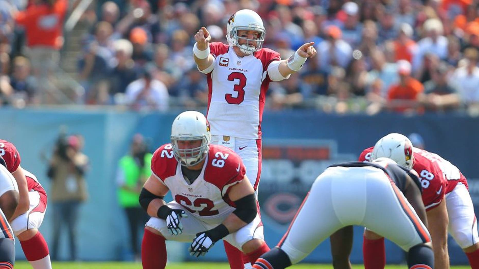 Sep 20, 2015; Chicago, IL, USA; Arizona Cardinals quarterback Carson Palmer (3) calls a play during the first half against the Chicago Bears at Soldier Field. Mandatory Credit: Dennis Wierzbicki-USA TODAY Sports